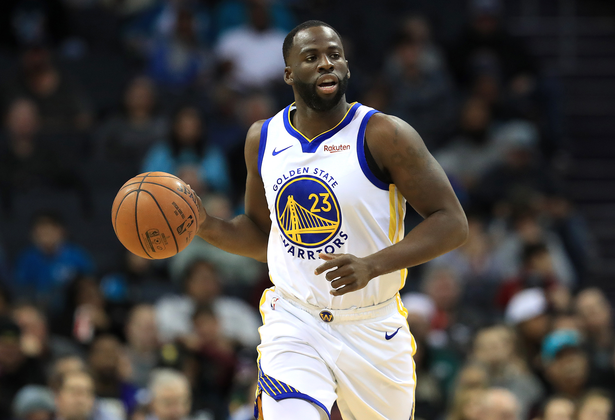 Draymond Green of the Golden State Warriors brings the ball up the court against the Charlotte Hornets during their game at Spectrum Center on December 4, 2019 in Charlotte, North Carolina.