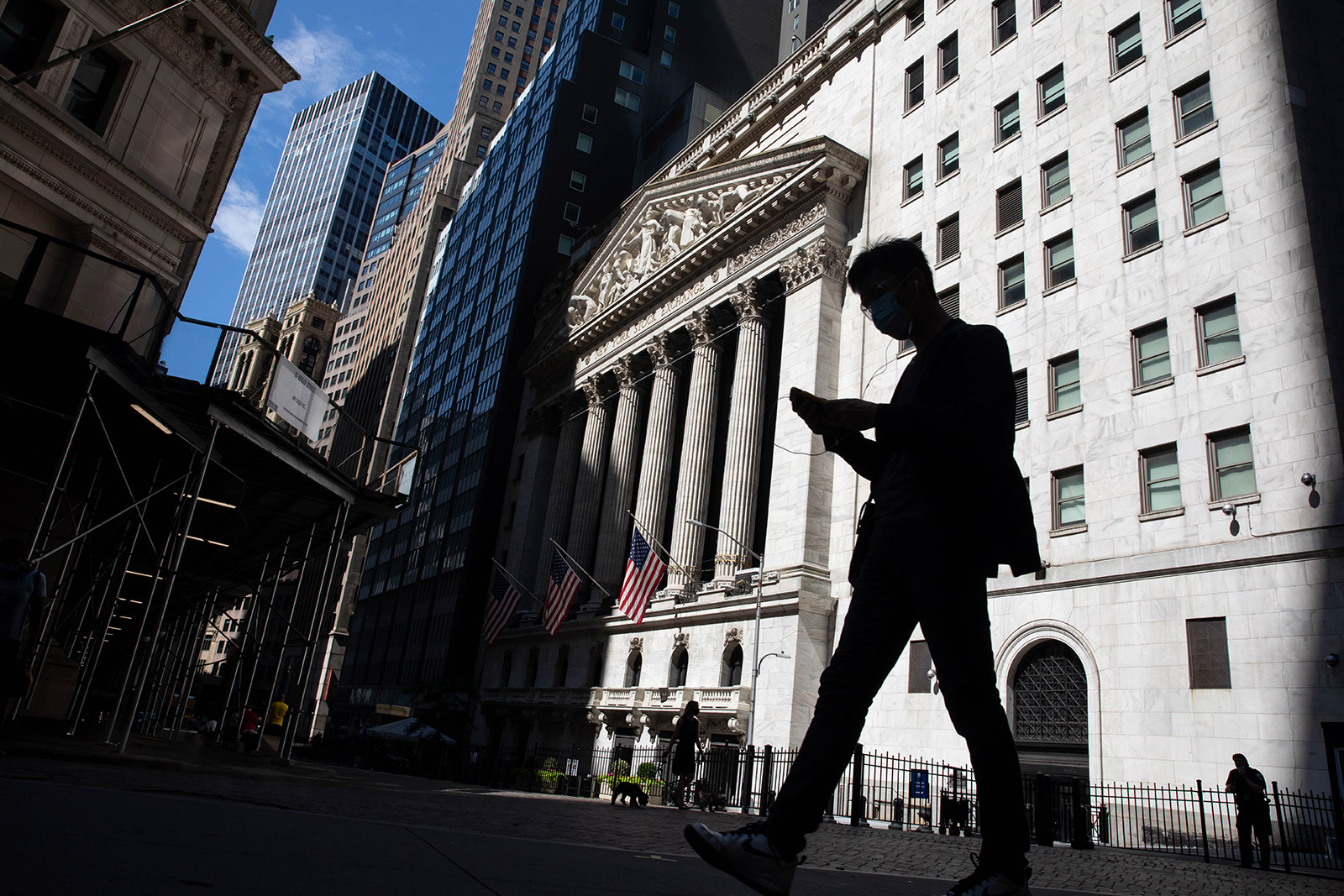 A pedestrian passes in front of the New York Stock Exchange on Monday.