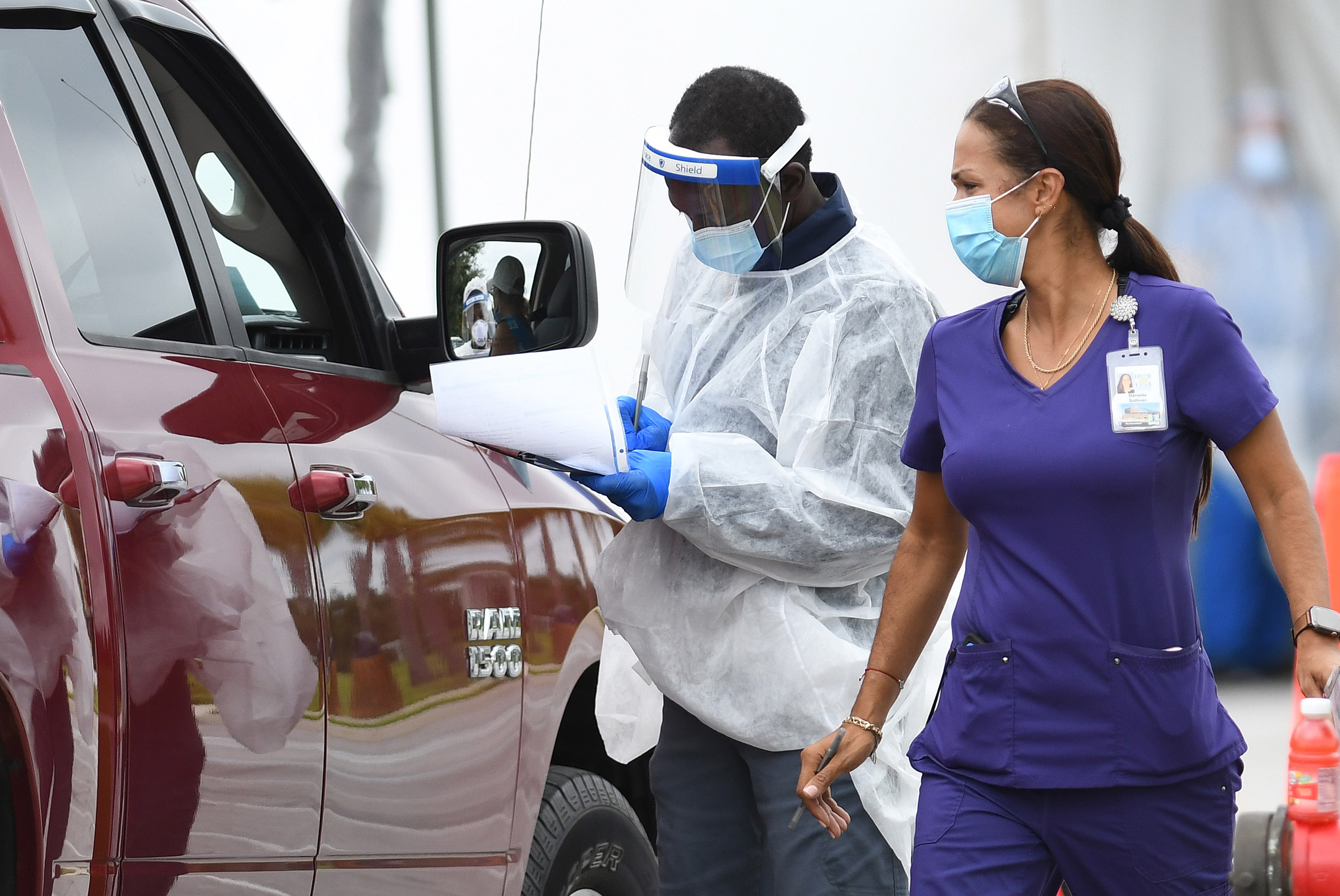 Health care workers operate a drive-through Covid-19 testing site at East Orange District Park on October 1, in Orlando, Florida.