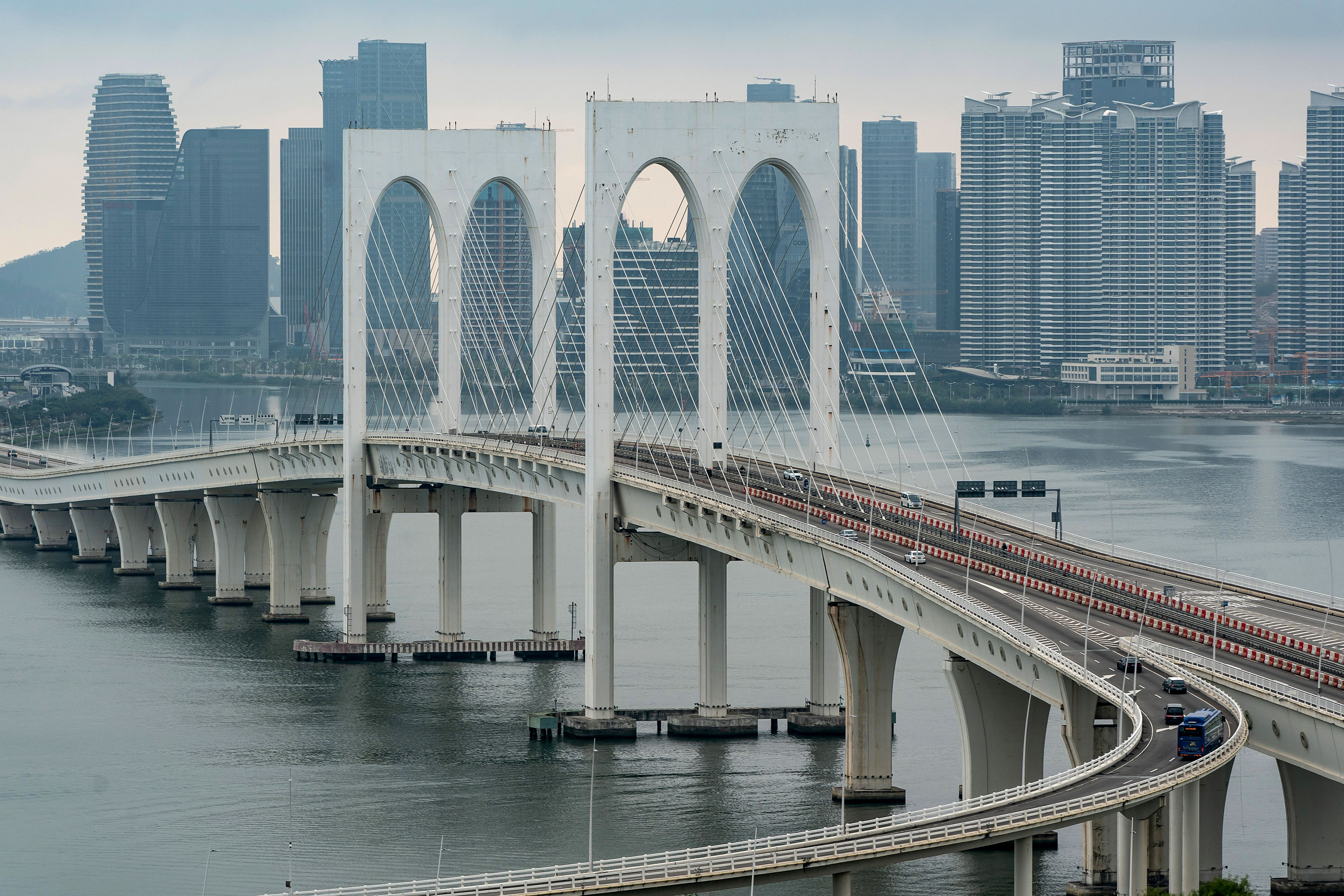 Vehicles drive across a bridge on February 5 in Macao, China.