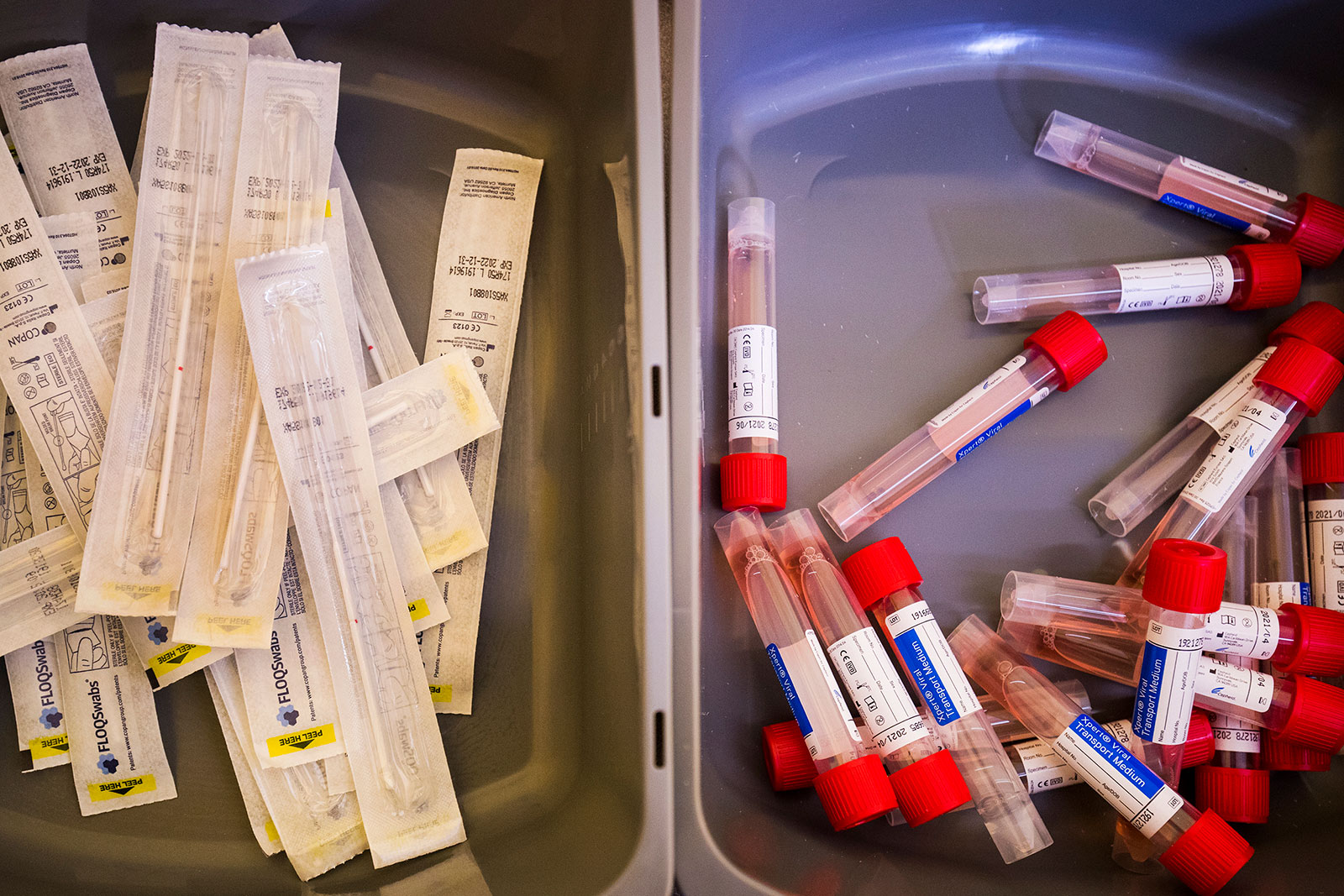 Vials and swabs sit in bins at a coronavirus testing center in Newton, Massachusetts, on March 18.