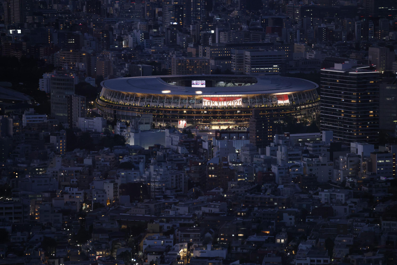 Tokyo Olympic Stadium is illuminated on July 22.