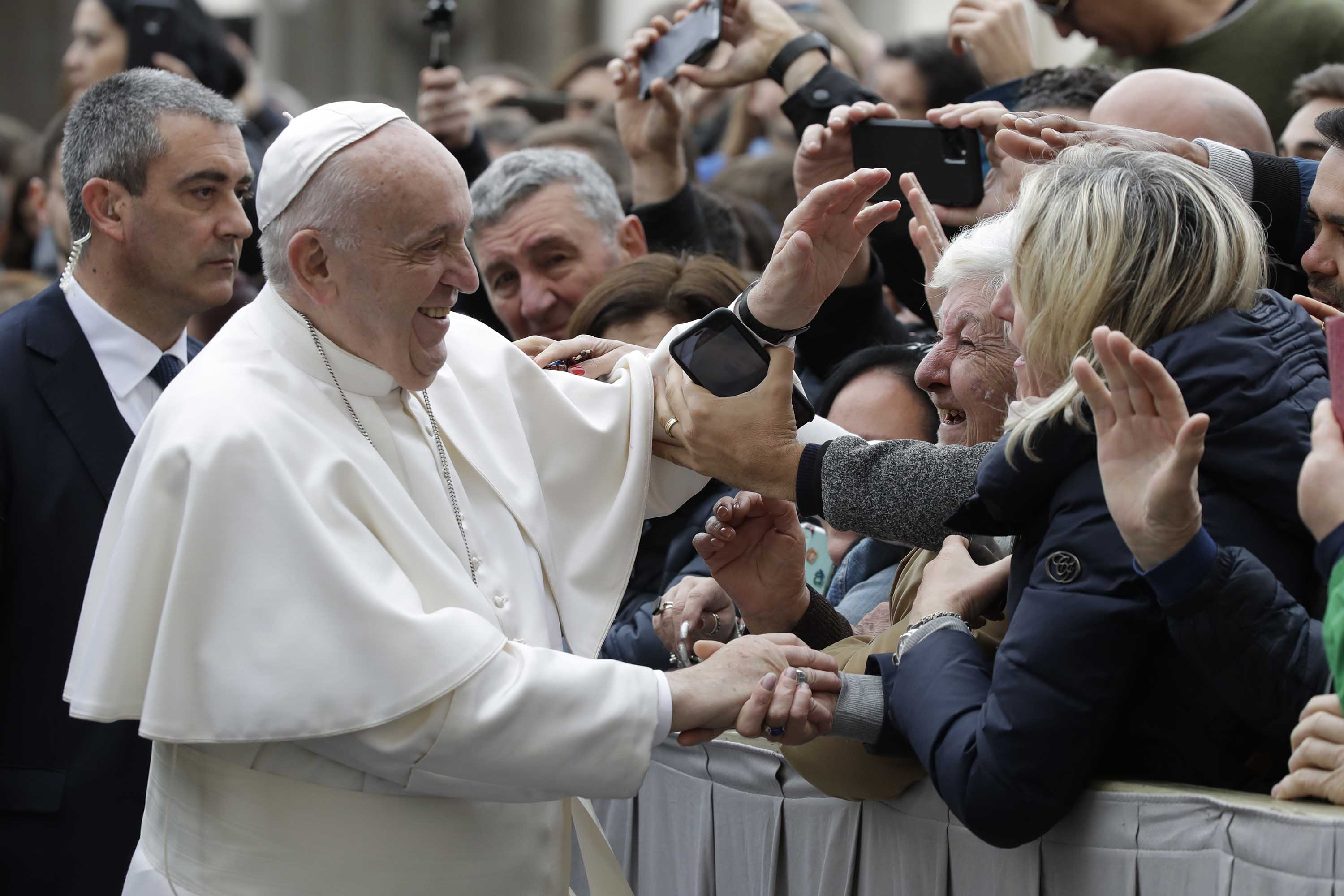 Pope Francis greets people in St. Peter's Square at the Vatican on Wednesday.