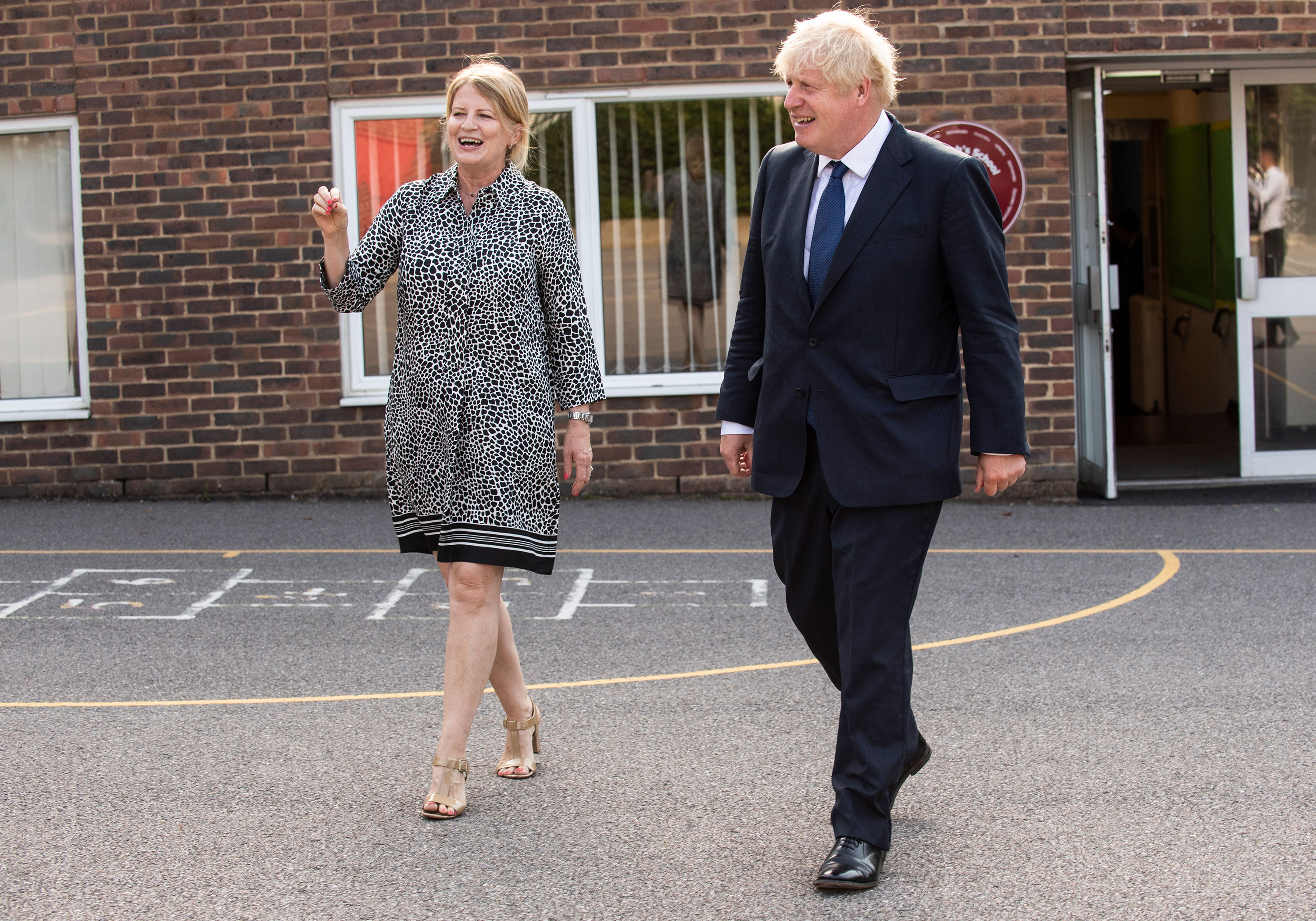 UK Prime Minister Boris Johnson speaks with head teacher, Bernadette Matthews during a visit to St Joseph's Catholic School in Upminster, London, on August 10, to see its new Covid-19 preparedness plans.
