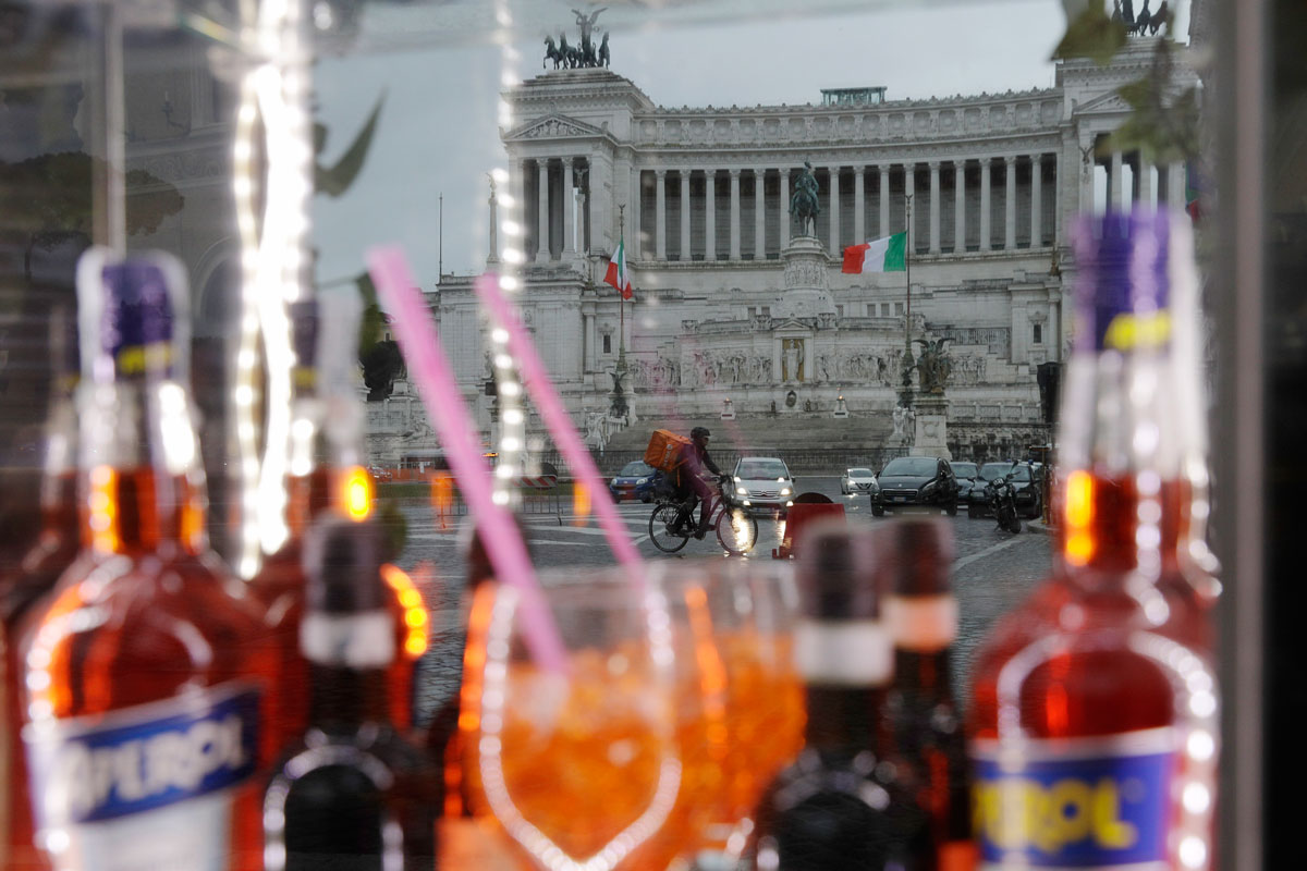 Piazza Venezia Square is reflected in the window of a closed coffee bar following Covid-19 restriction measures in Rome, Italy on January 22.