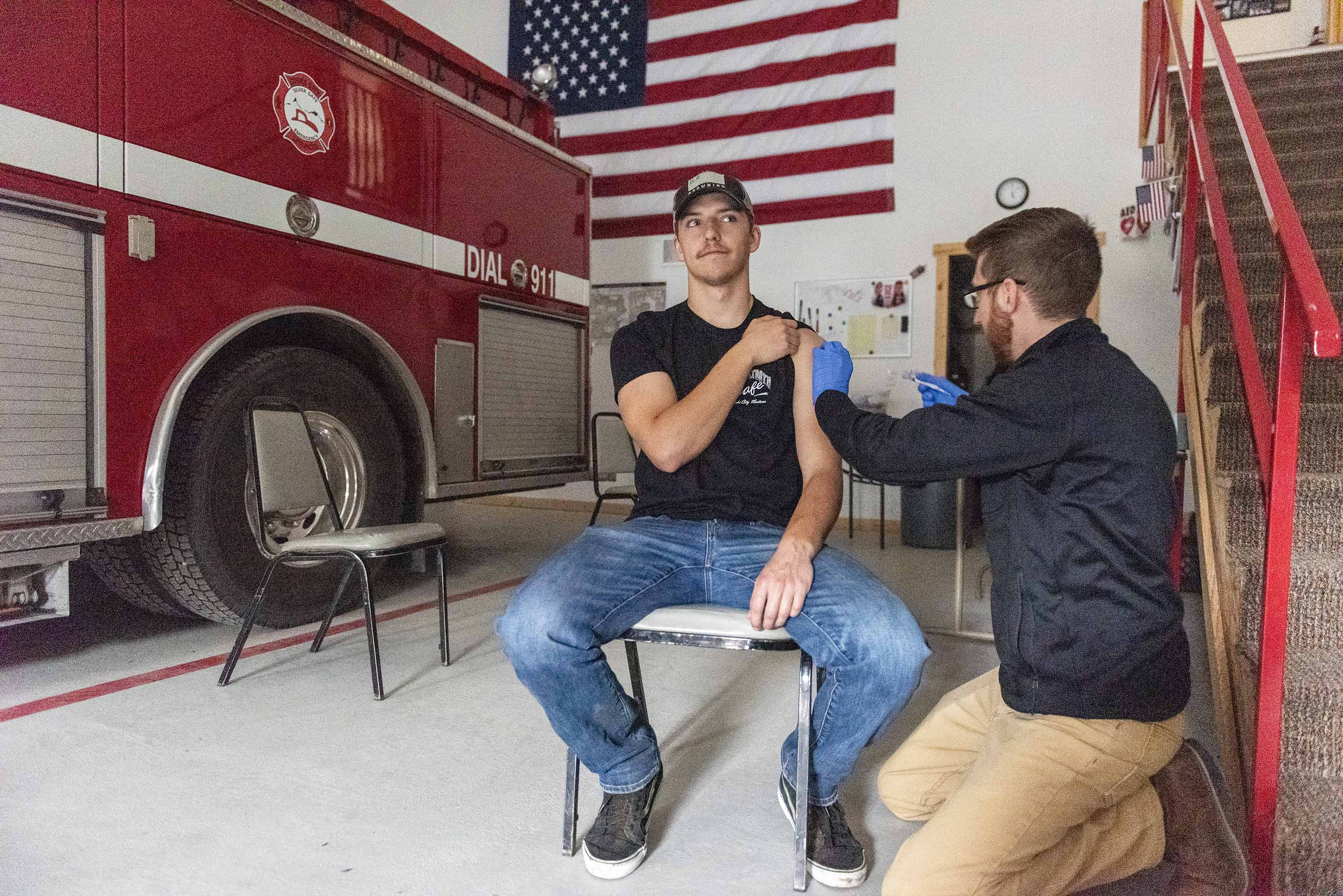 Zack Cather is vaccinated with the Johnson & Johnson vaccine at a clinic set up at a firehouse in Cooke City, Montana, on June 8.