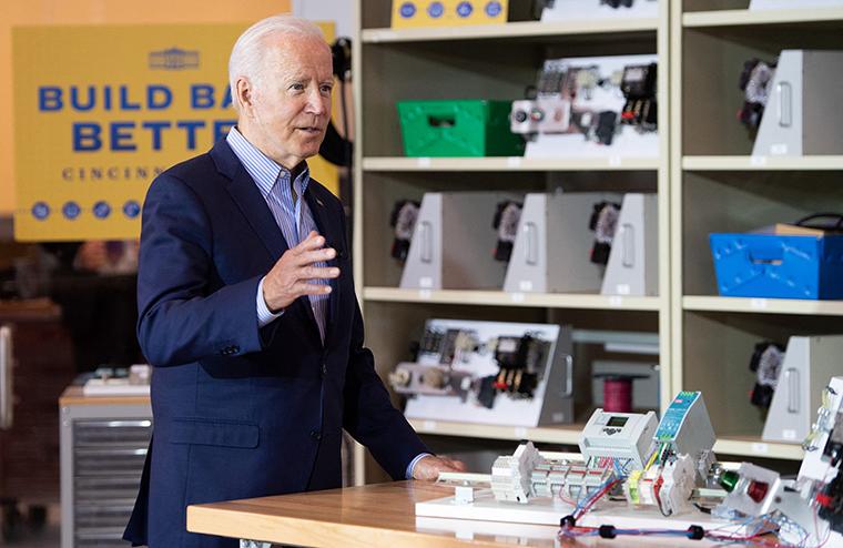 US President Joe Biden tours the IBEW / NECA Electrical Training Center in Cincinnati, Ohio,  on July 21.