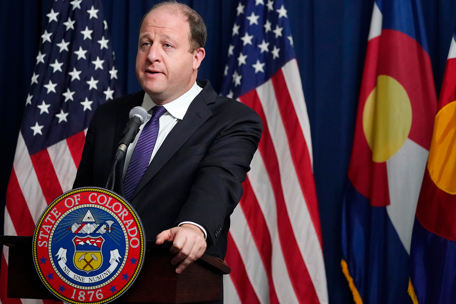 Colorado Governor Jared Polis speaks during a news conference in Denver, on November 13.