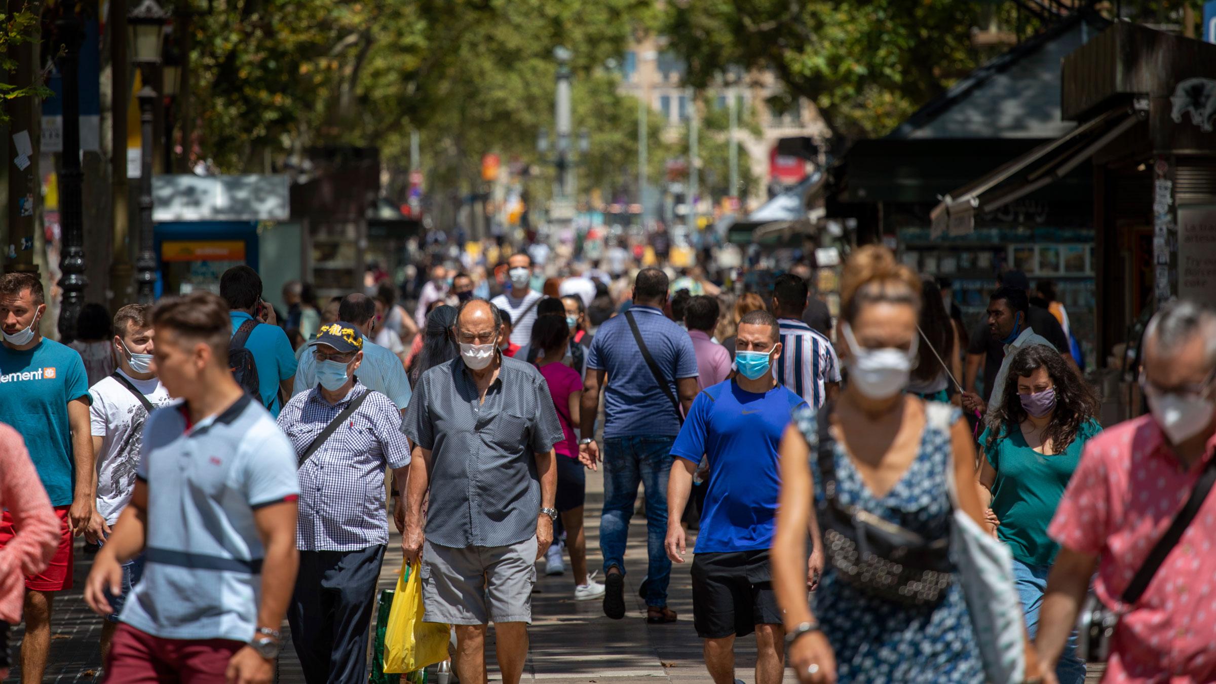 People walk along Las Ramblas in Barcelona, Spain, on Thursday.