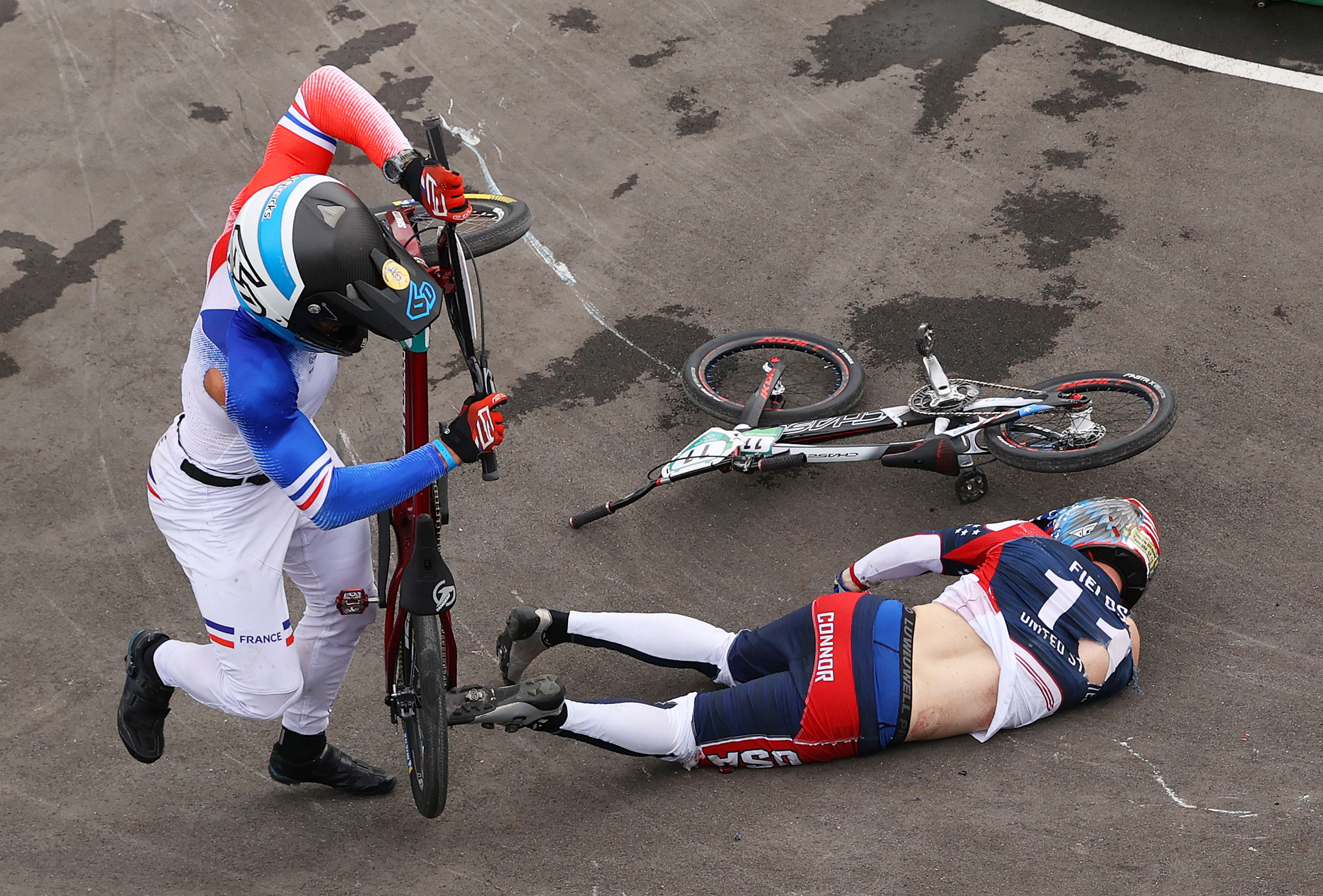 France's Romain Mahieu and the United States' Connor Fields crash during a BMX semifinal heat on July 30.