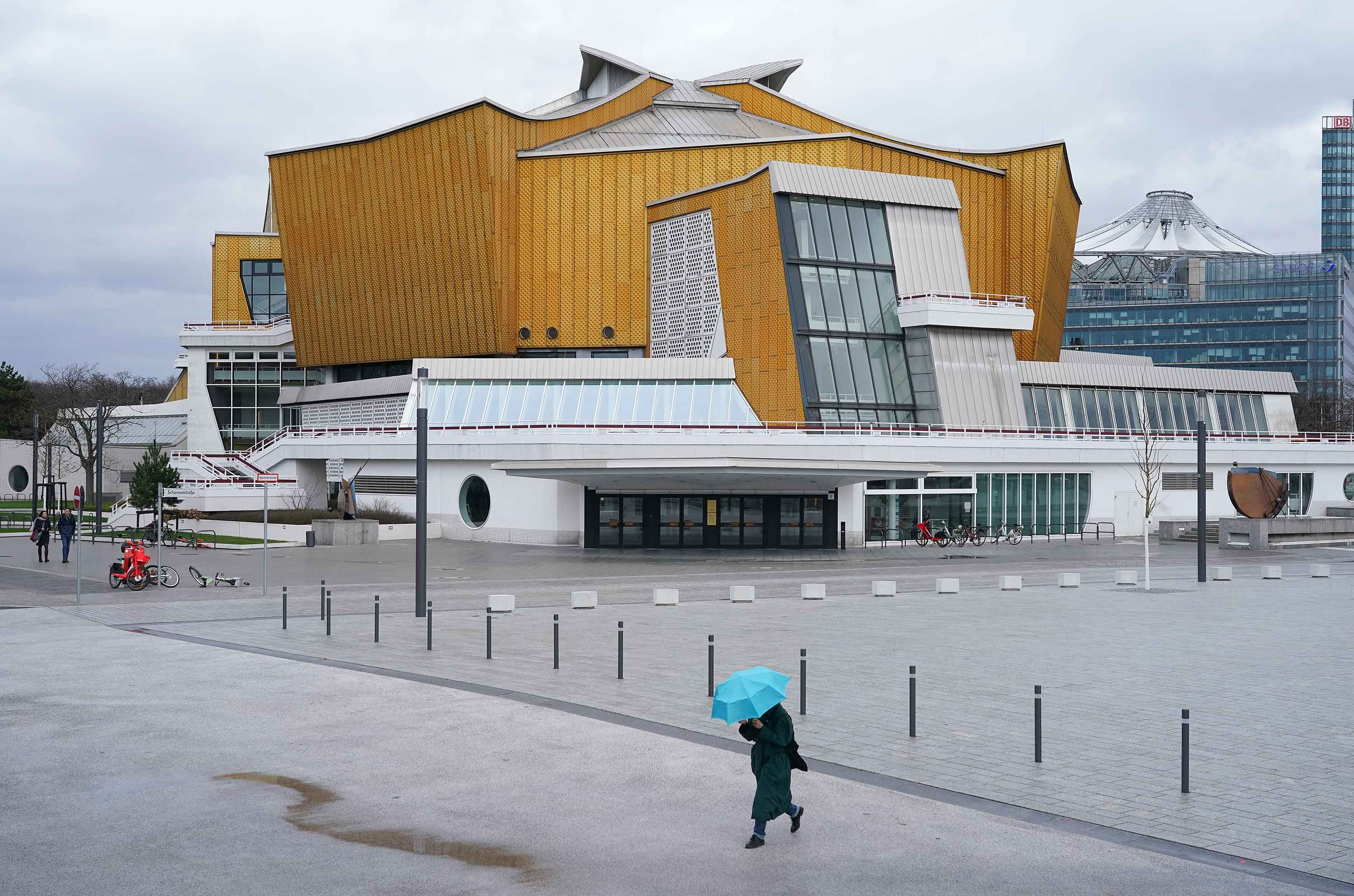 A person walks past the Berliner Philharmonie concert hall in Berlin, Germany, on Thursday.