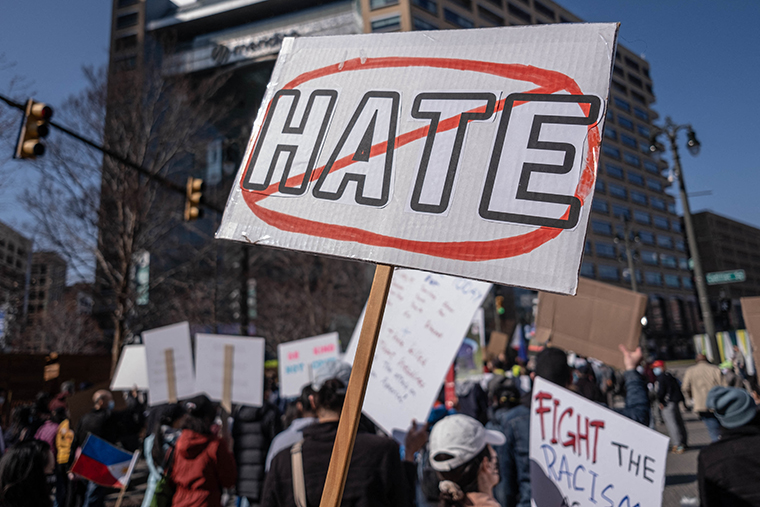 People march during a Stop Asian Hate rally in downtown Detroit, Michigan on March 27, 2021.
