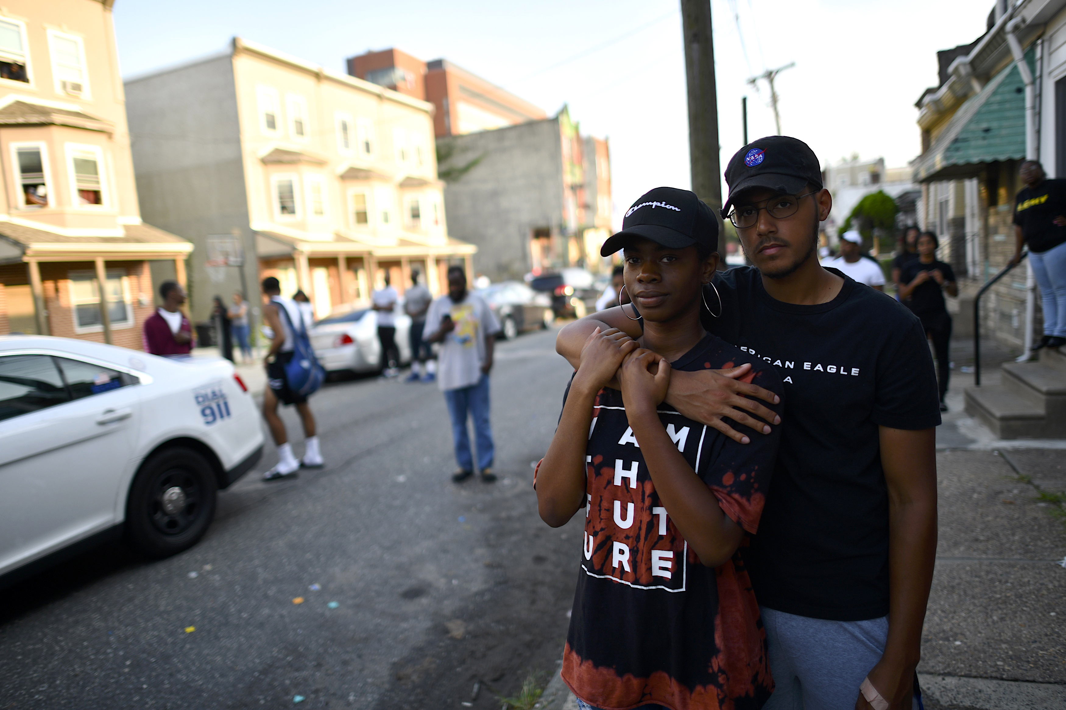 Onlookers gather near the scene of a shooting on August 14, 2019 in Philadelphia.