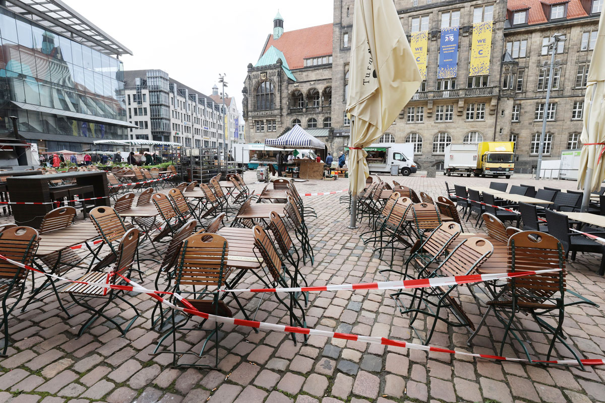 Empty tables and chairs are cordoned off outside a downtown restaurant during the lockdown in Chemnitz, Germany on May 6.
