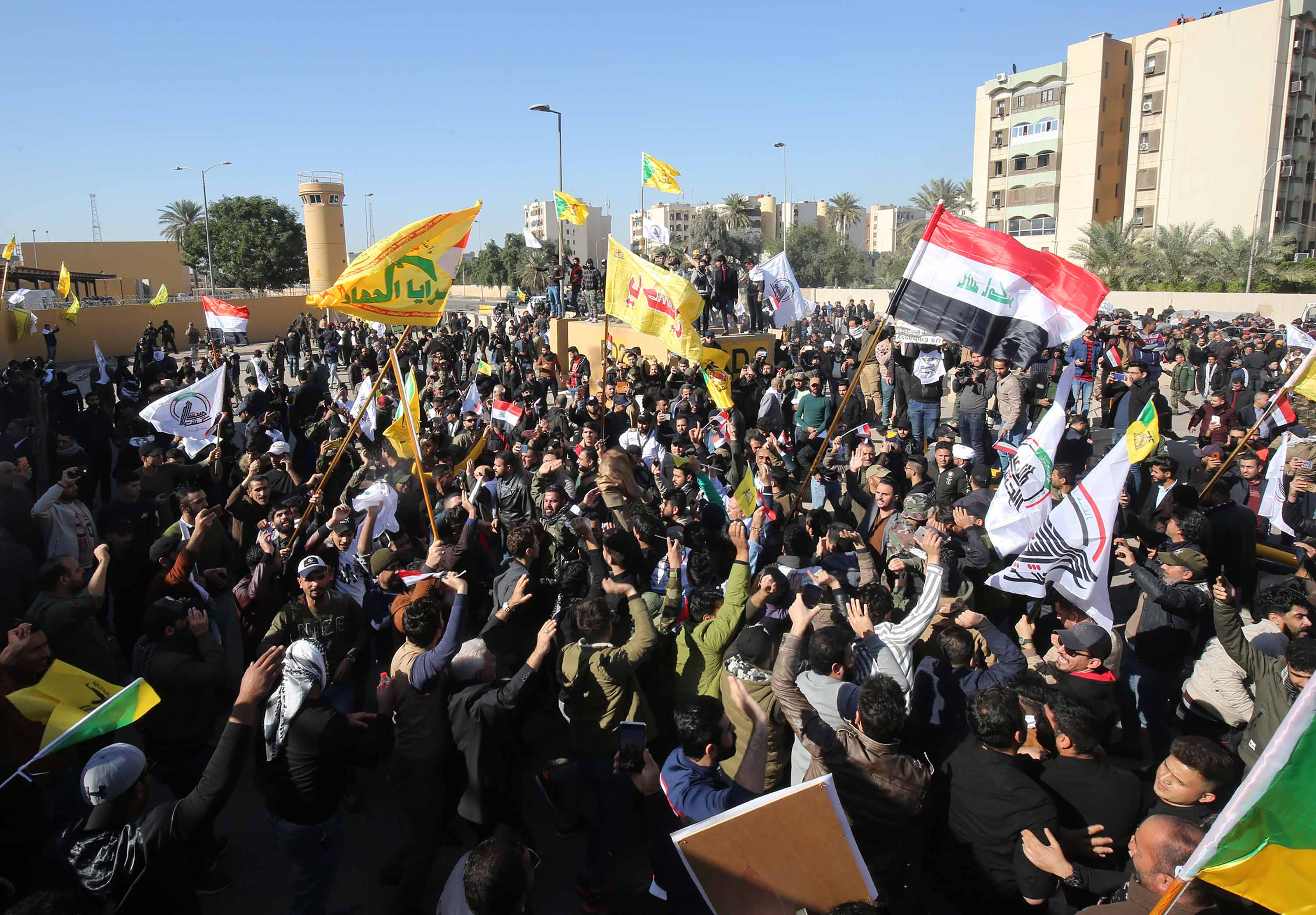 A crowd of protesters demonstrate outside the US embassy in the Iraqi capital on Tuesday.