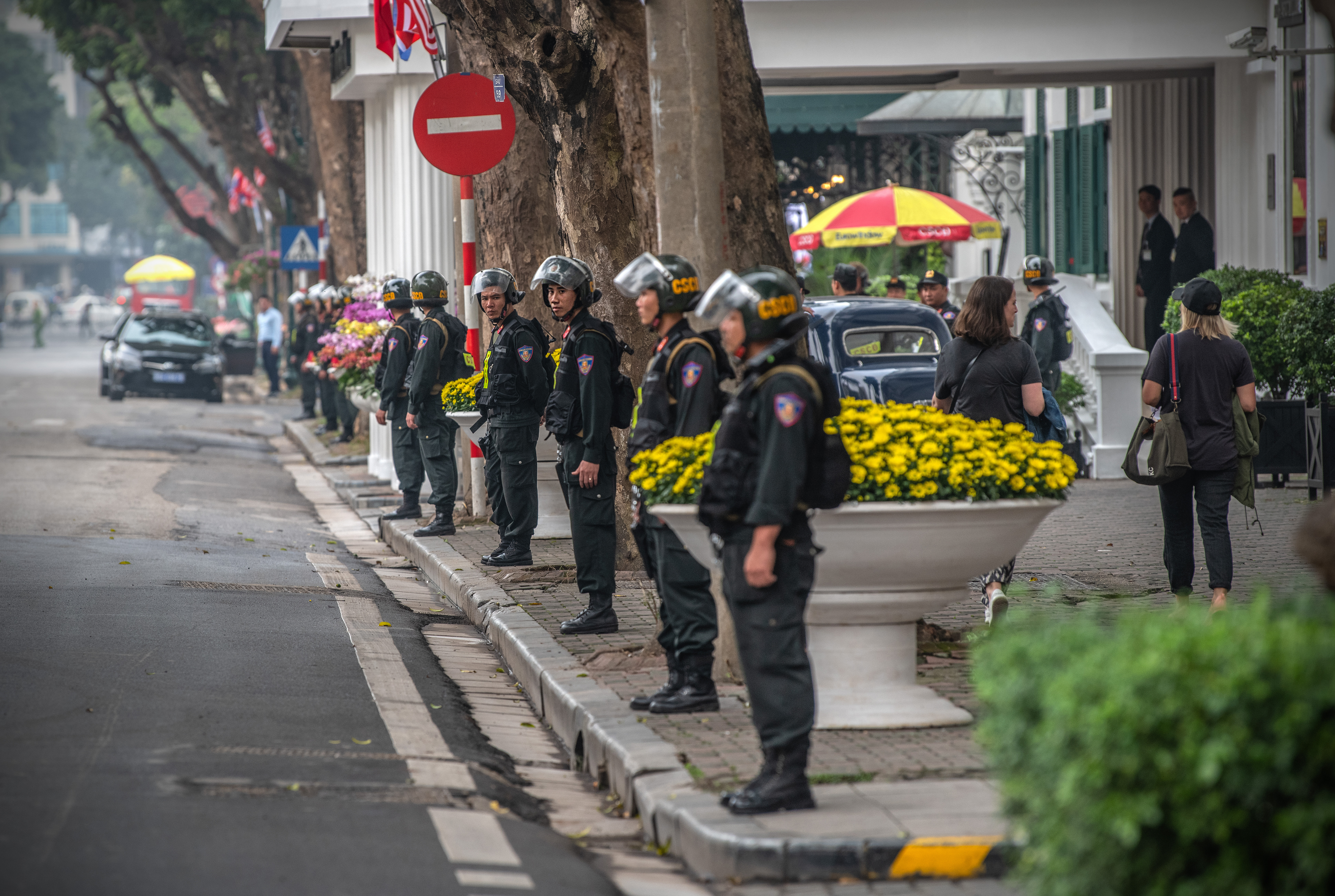 Police officers line up outside the Hotel Metropole in Hanoi where Kim and Trump will meet again on Thursday.