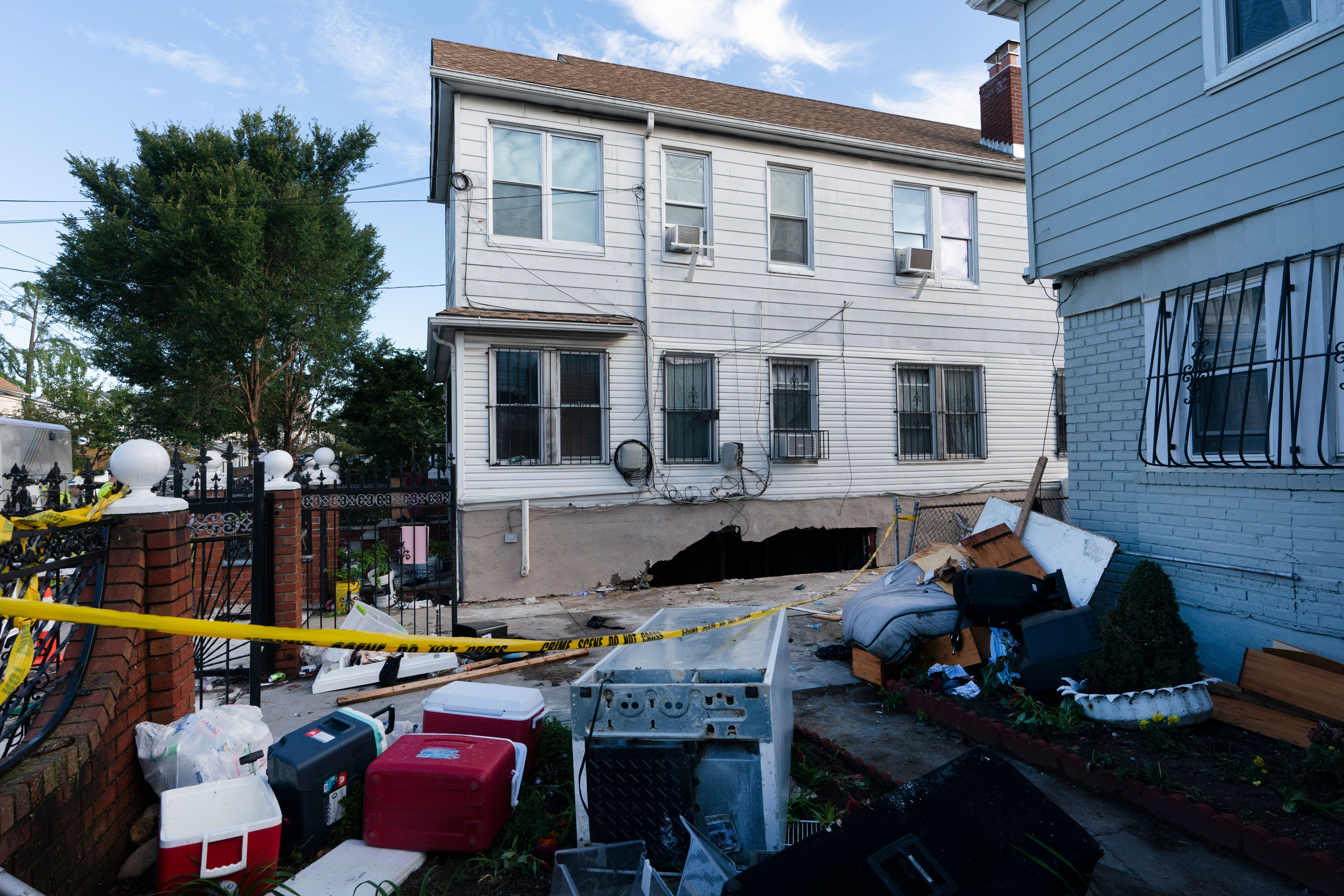 A building in Queens, New York, is damaged on September 2. Some of the occupants were killed when several feet of water collapsed the wall to their basement apartment and flooded it.