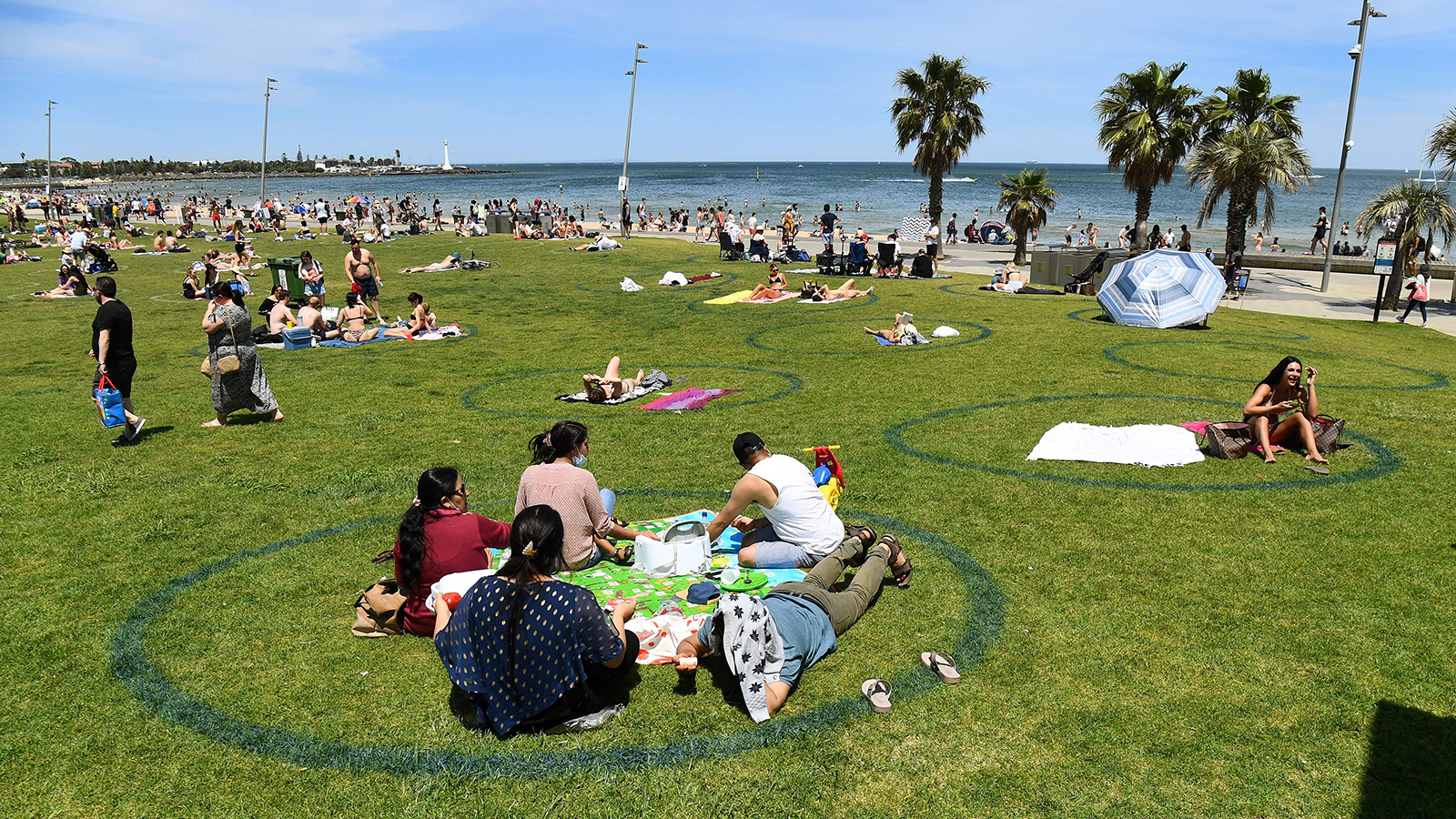People enjoy the warm weather on Melbourne's St. Kilda Beach on November 3.