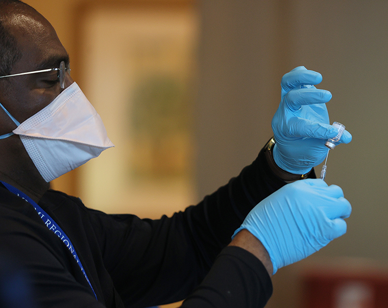 A healthcare worker prepares a dose of the Pfizer-BioNtech COVID-19 vaccine in Pompano Beach, Florida.