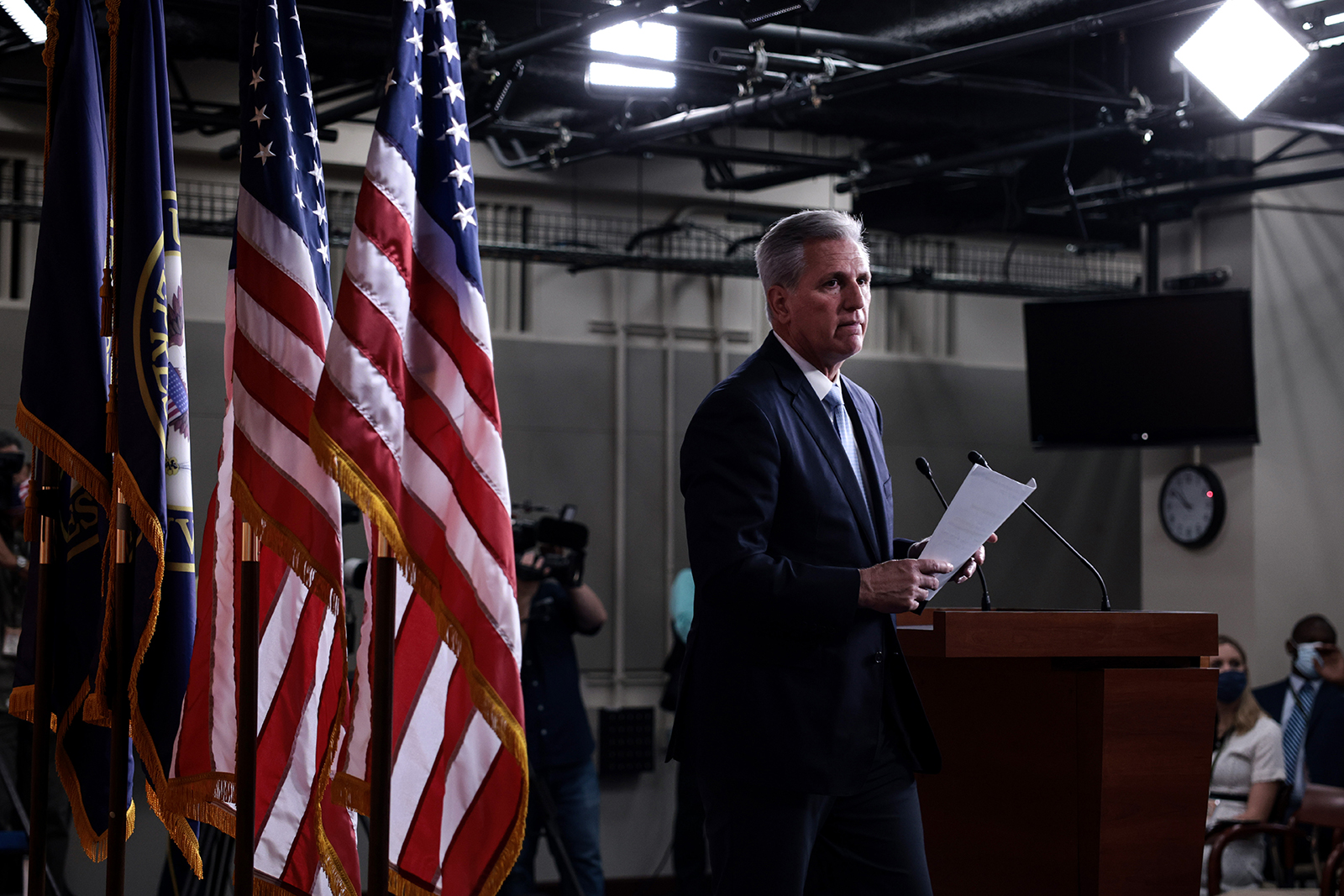 House Minority Leader Kevin McCarthy departs from the podium after speaking at a press conference at the Capitol building on August 27 in Washington.