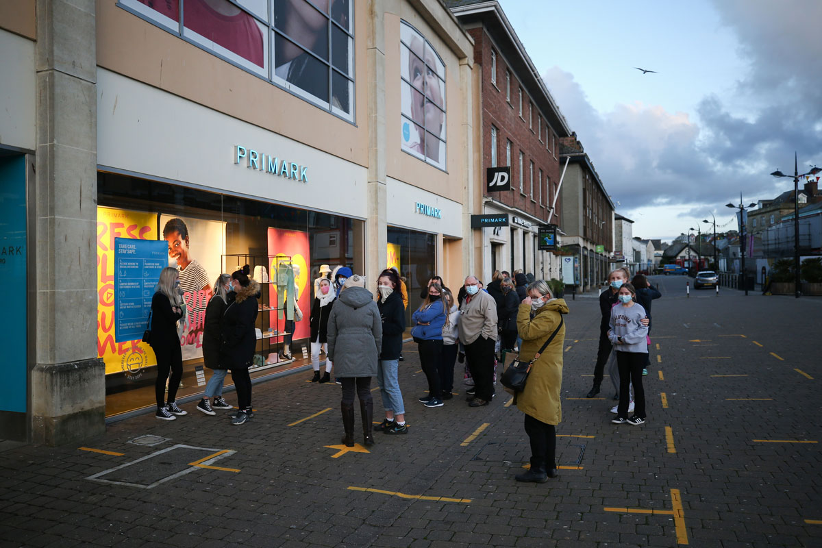 People line up to enter Primark as it opens for the first time since lockdown restrictions were last introduced on April 12, 2021 in Truro, England.