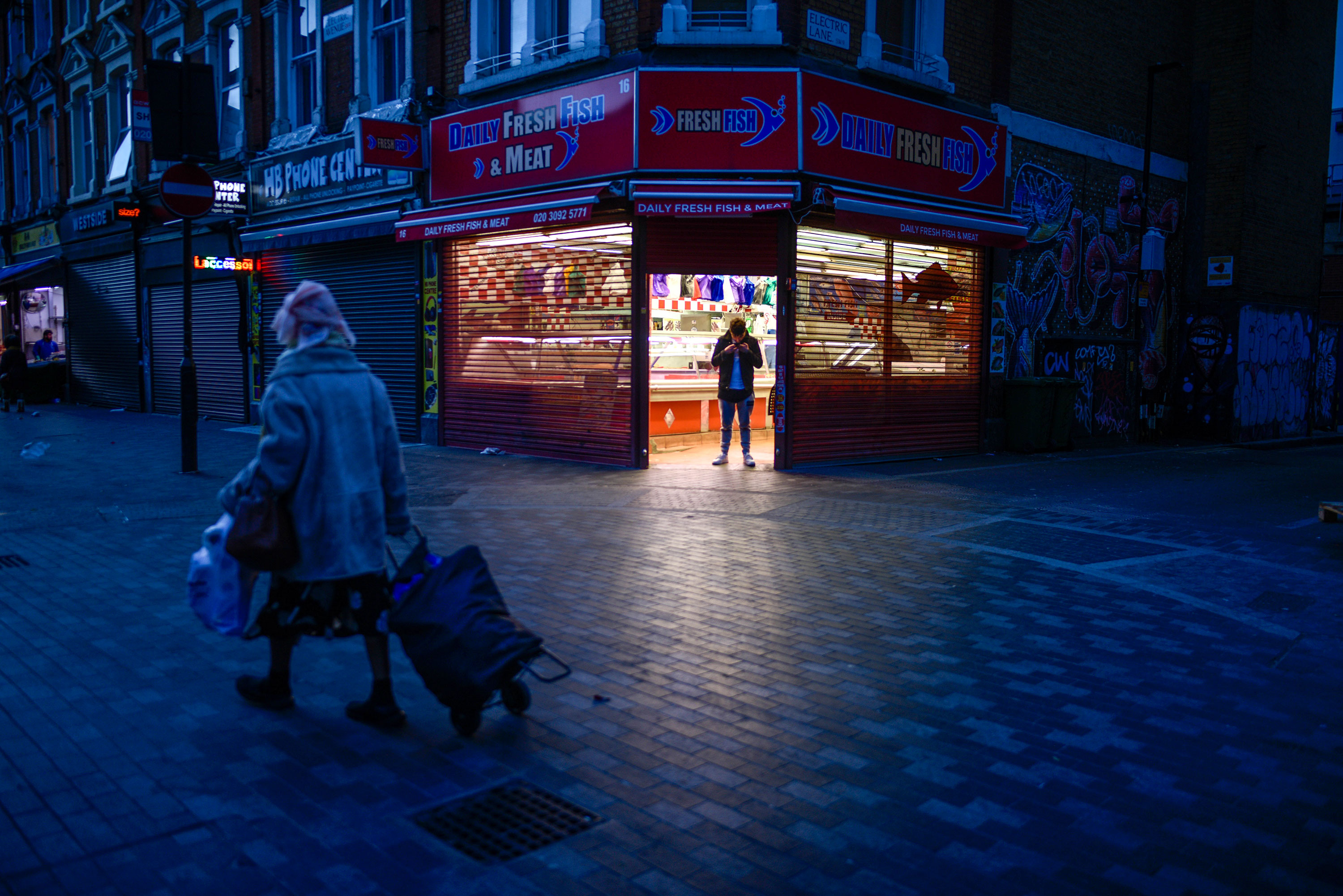 A woman walks past a butcher's shop this weekend in Brixton, south London.