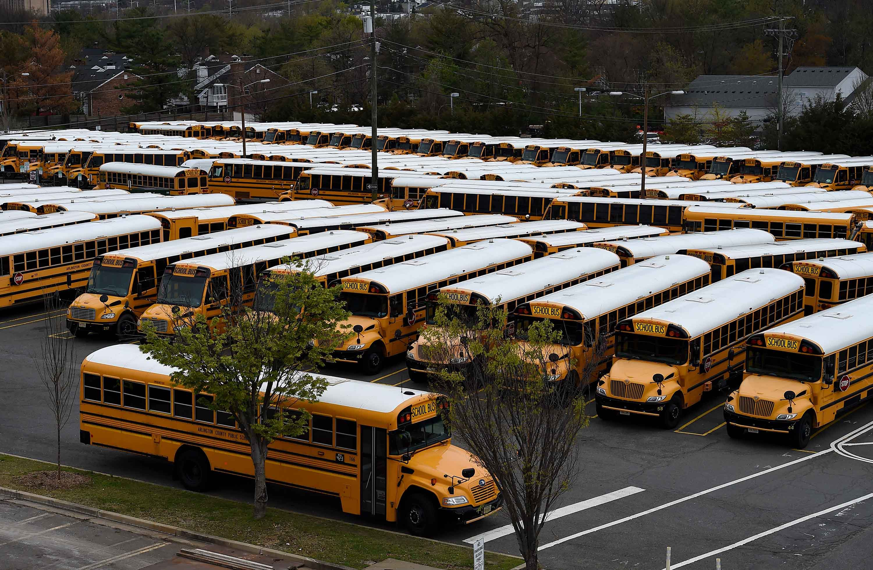 School buses are parked at the Arlington County Bus Depot in Arlington, Virginia, on March 31.