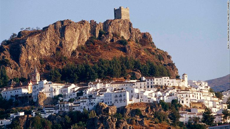 Zahara de la Sierra and its castle perch on a hilltop in Andalusia, Spain.