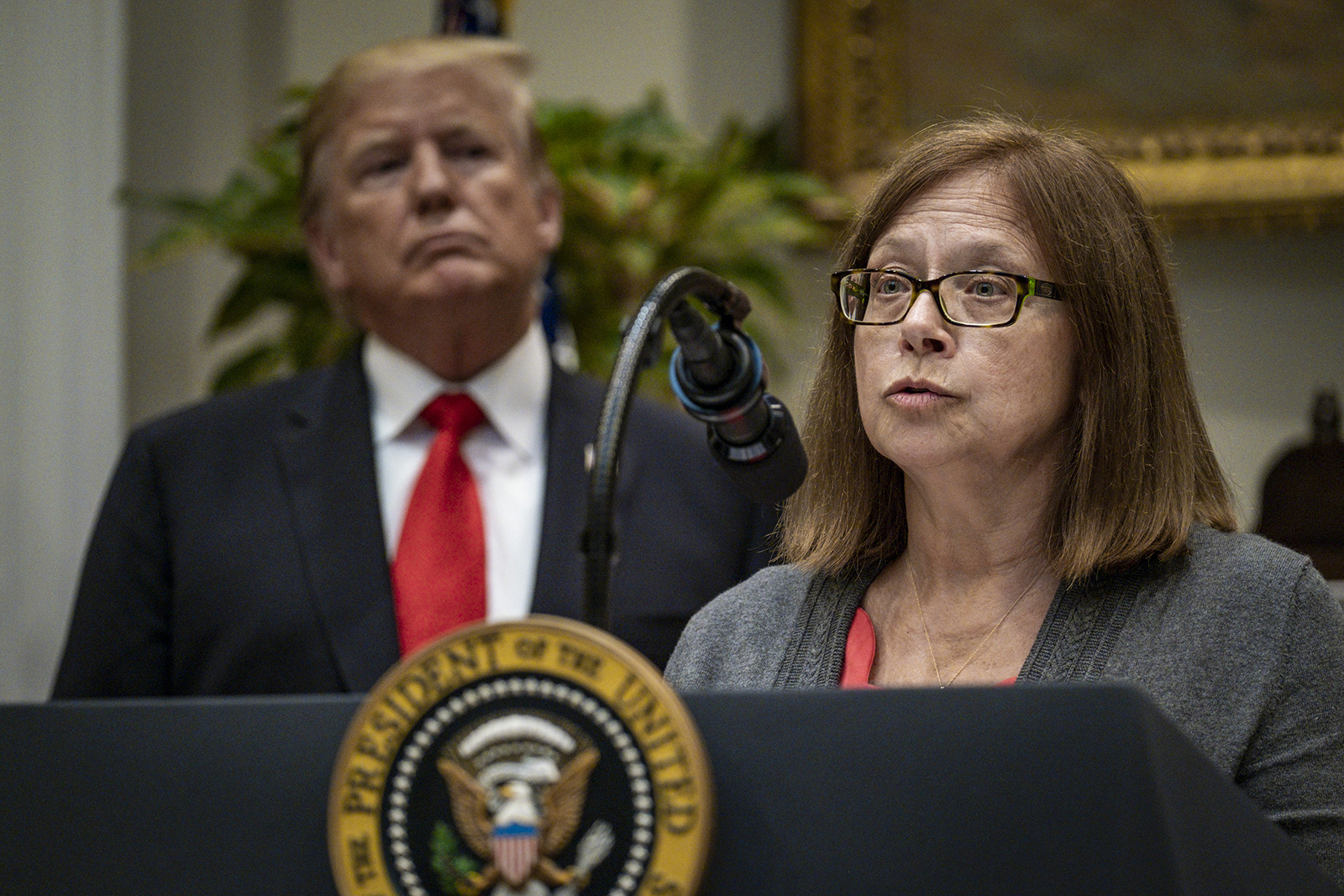 Elinore McCance-Katz, the assistant secretary for Mental Health and Substance Use, speaks while President Donald Trump, left, listens in the Roosevelt Room of the White House in Washington, DC, on September 4, 2019.