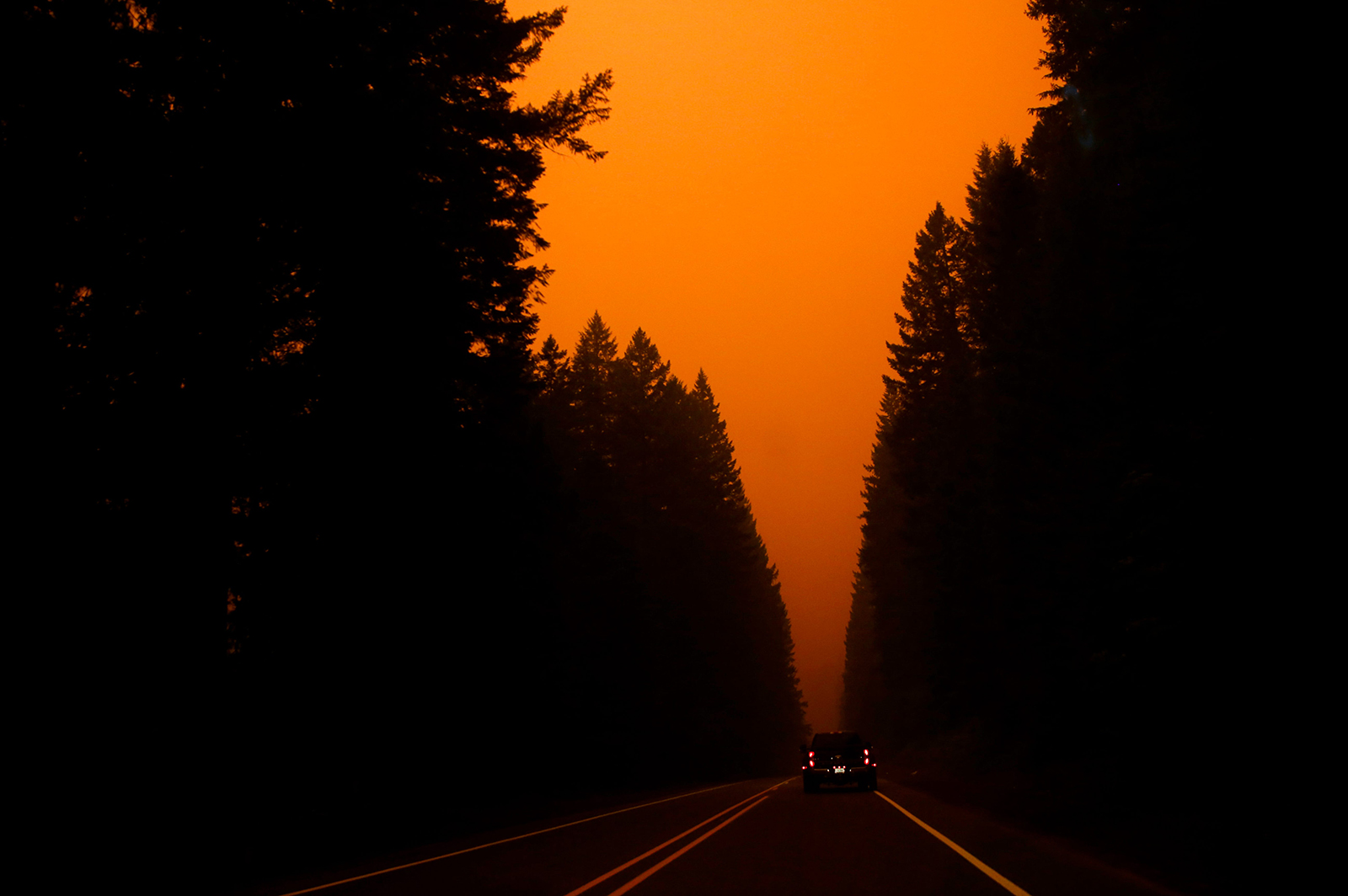 "Smoke from the Lionshead Fire and Beachie Creek Fire create an orange glow as an ""extremely critical"" fire warning is issued on Monday, September 7, in Oregon."