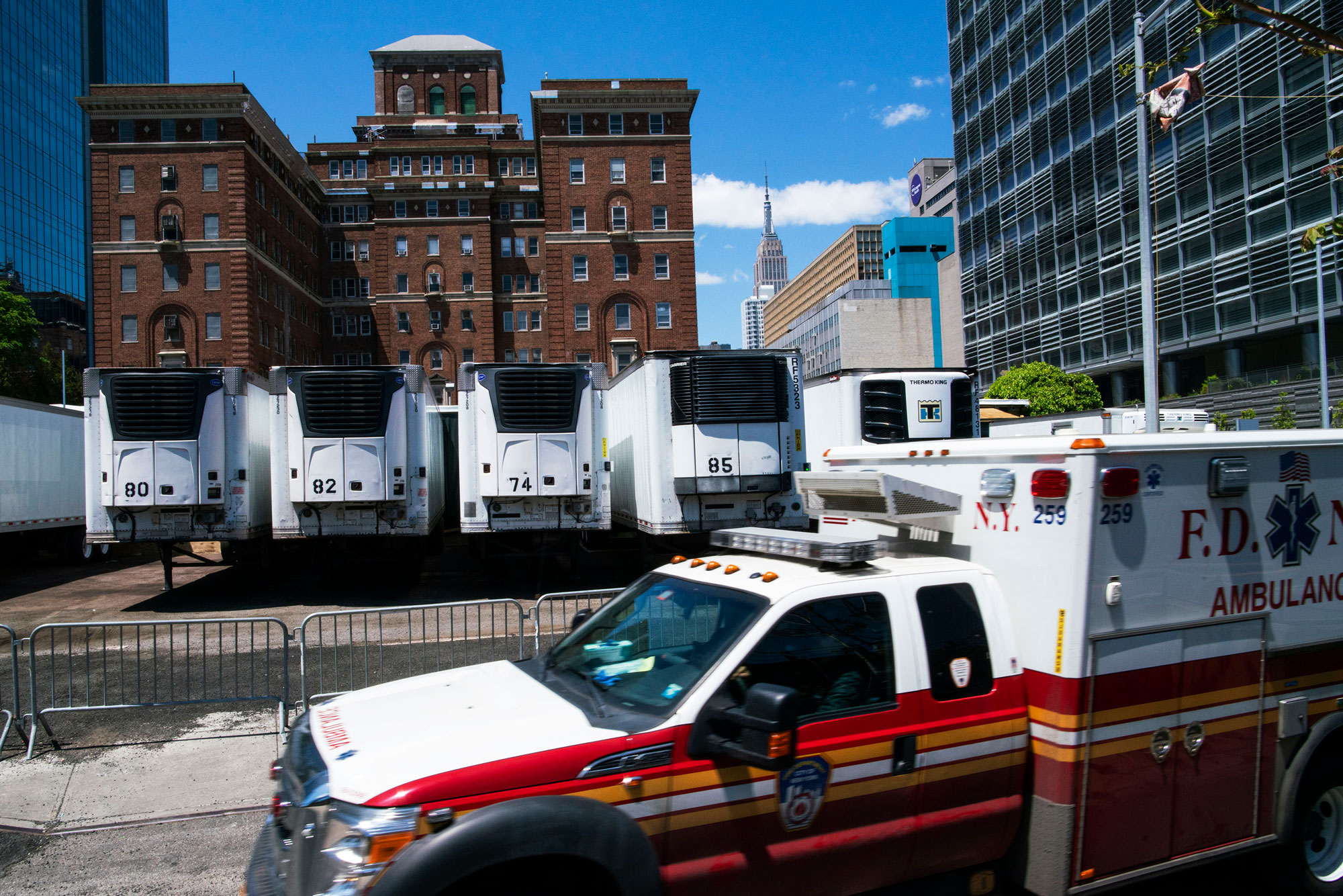 Trucks used as temporary morgues are seen outside the New York City Chief Medical Examiner's office on May 12 in New York City.