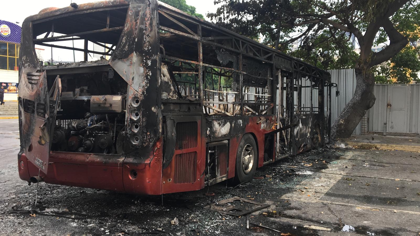 A burnt-out bus, also in the capital Wednesday morning.