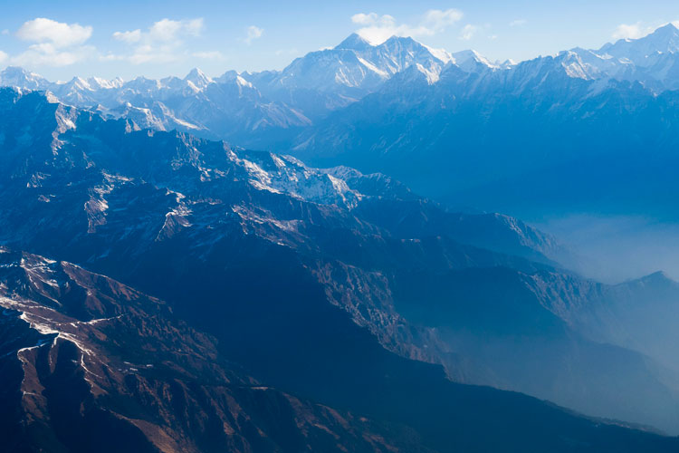 This picture taken from a commercial aircraft shows an aerial view of Mount Everest and the Himalayan mountain range on February 7.
