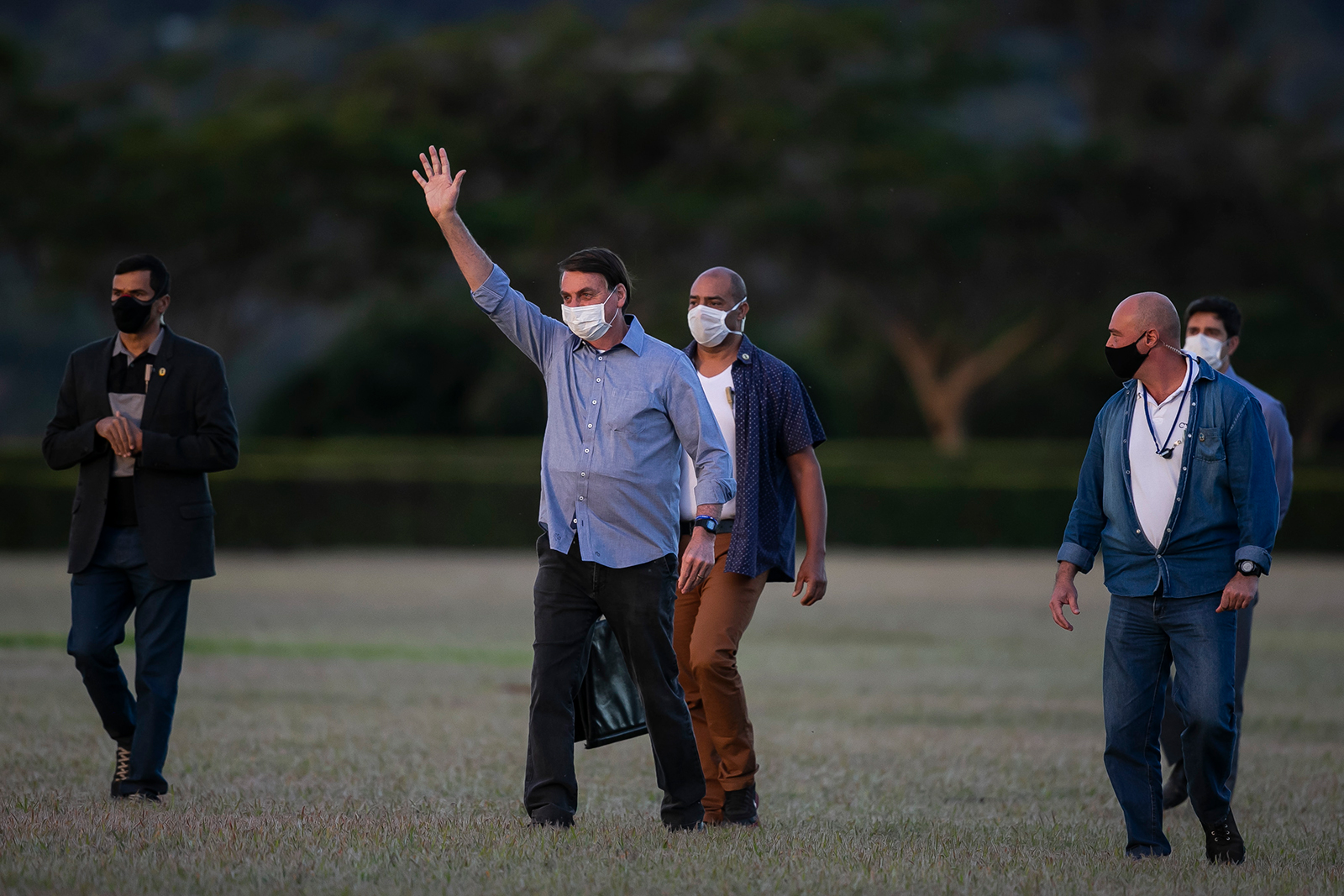 Jair Bolsonaro President of Brazil gestures in front of the official residence after testing positive for coronavirus in Alvorada Palace on July 19, in Brasilia, Brazil.