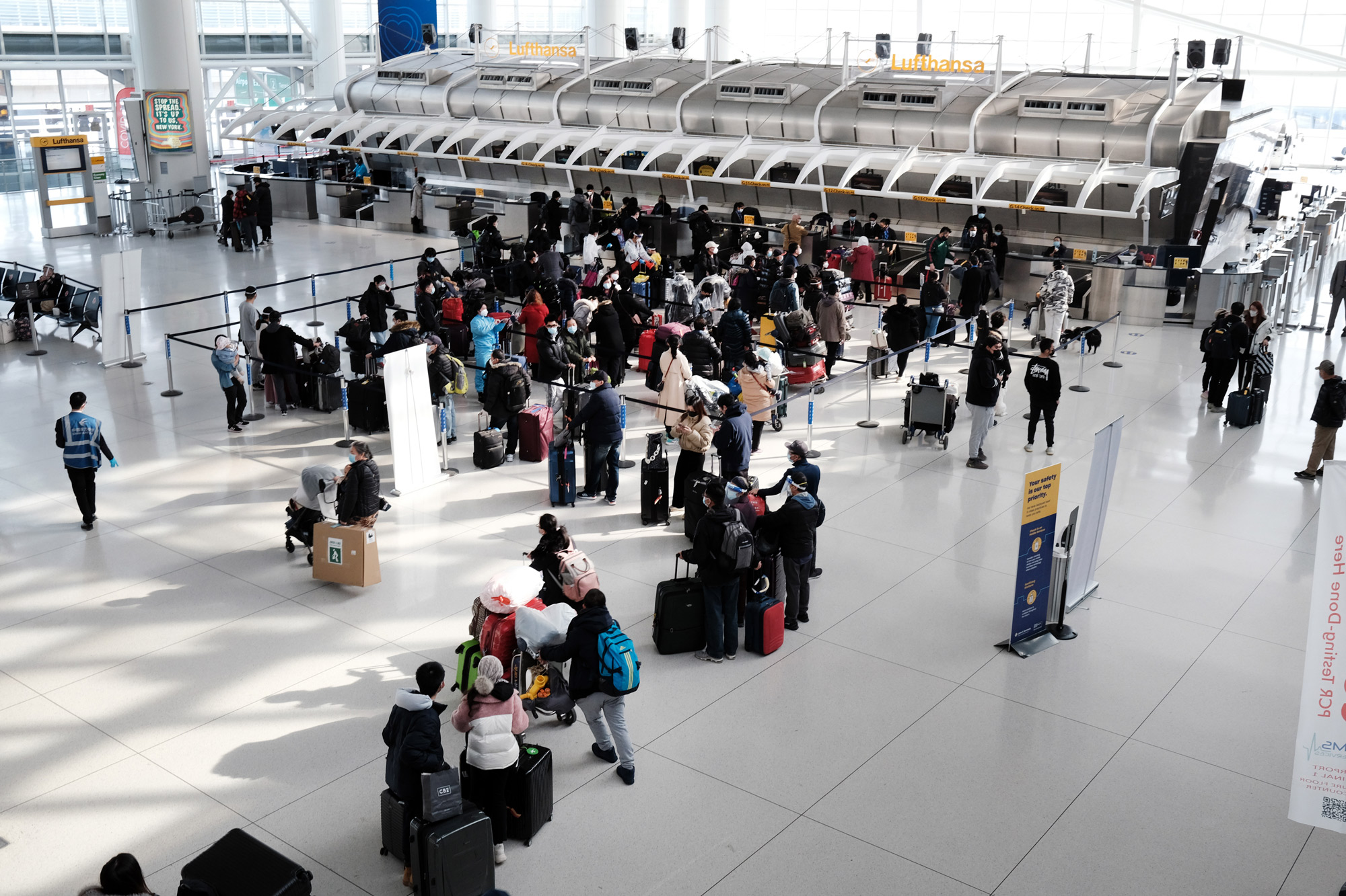People wait for a flight at an international terminal at John F. Kennedy Airport on January 25 in New York City.