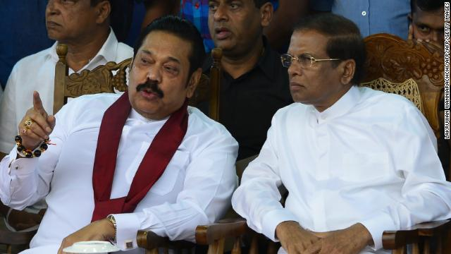 Sri Lanka's President Maithripala Sirisena (R) and Prime Minister Mahinda Rajapaksa speak during a rally in Colombo.