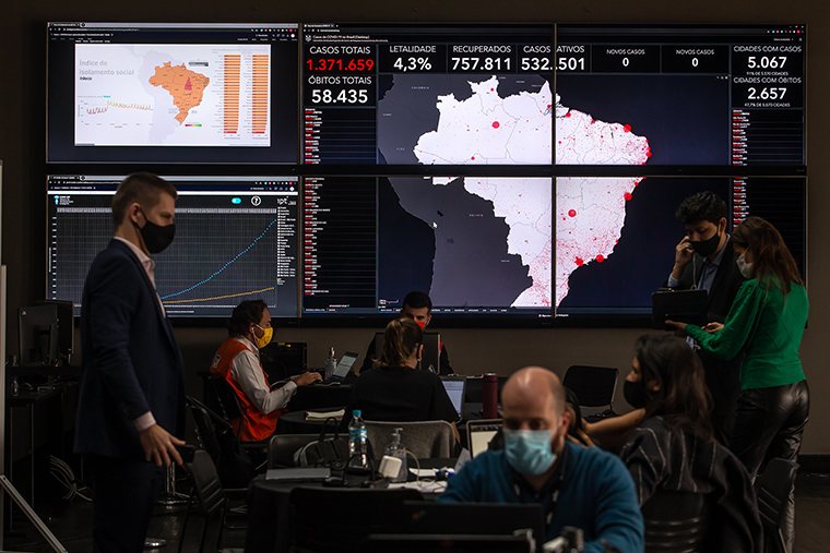 Workers monitor data inside the Ministry of Science, Innovation, Technology and Communication's crisis management command center in Sao Paulo, Brazil, on Tuesday, June 30. Brazil's telecommunications operators have provided the government with geolocation data to help monitor population mobility, concentration and risk of contamination in an effort to help stop the spread of the coronavirus.