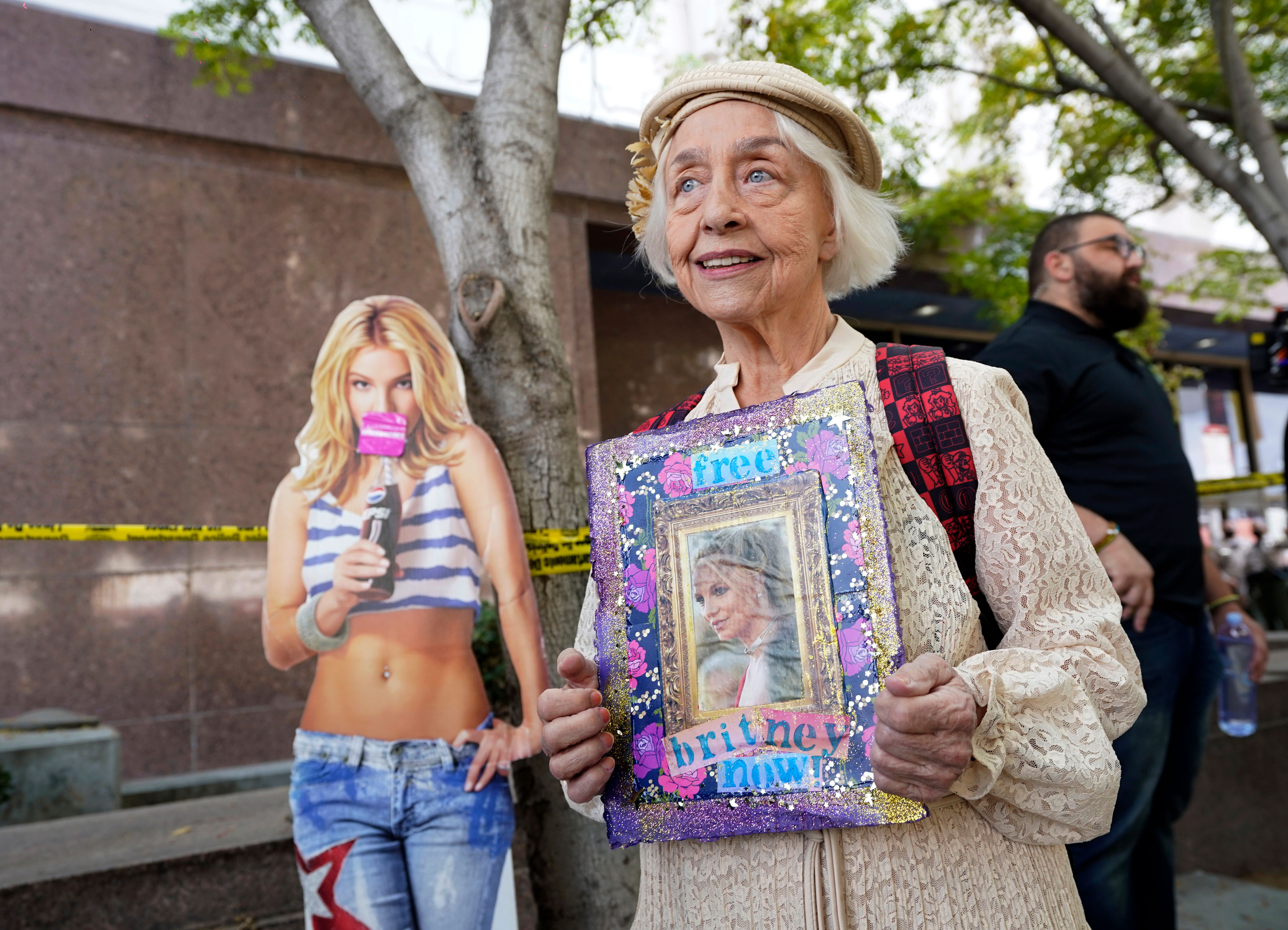 A Britney Spears supporter holds a sign outside the Stanley Mosk Courthouse in Los Angeles on September 29.