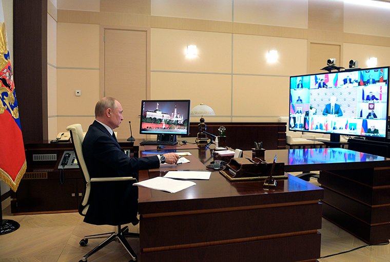 Russian President Vladimir Putin attend a meeting via video conference with heads of local governments at the Novo-Ogaryovo residence outside Moscow, Wednesday, April 8.