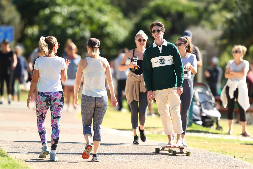 People walk and skate along the Burleigh Heads foreshore at the Gold Coast, Australia, on May 2.