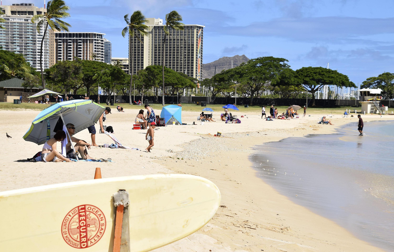 Visitors are seen at Ala Moana Beach in Honolulu, Hawaii, on July 29, amid the novel coronavirus outbreak.