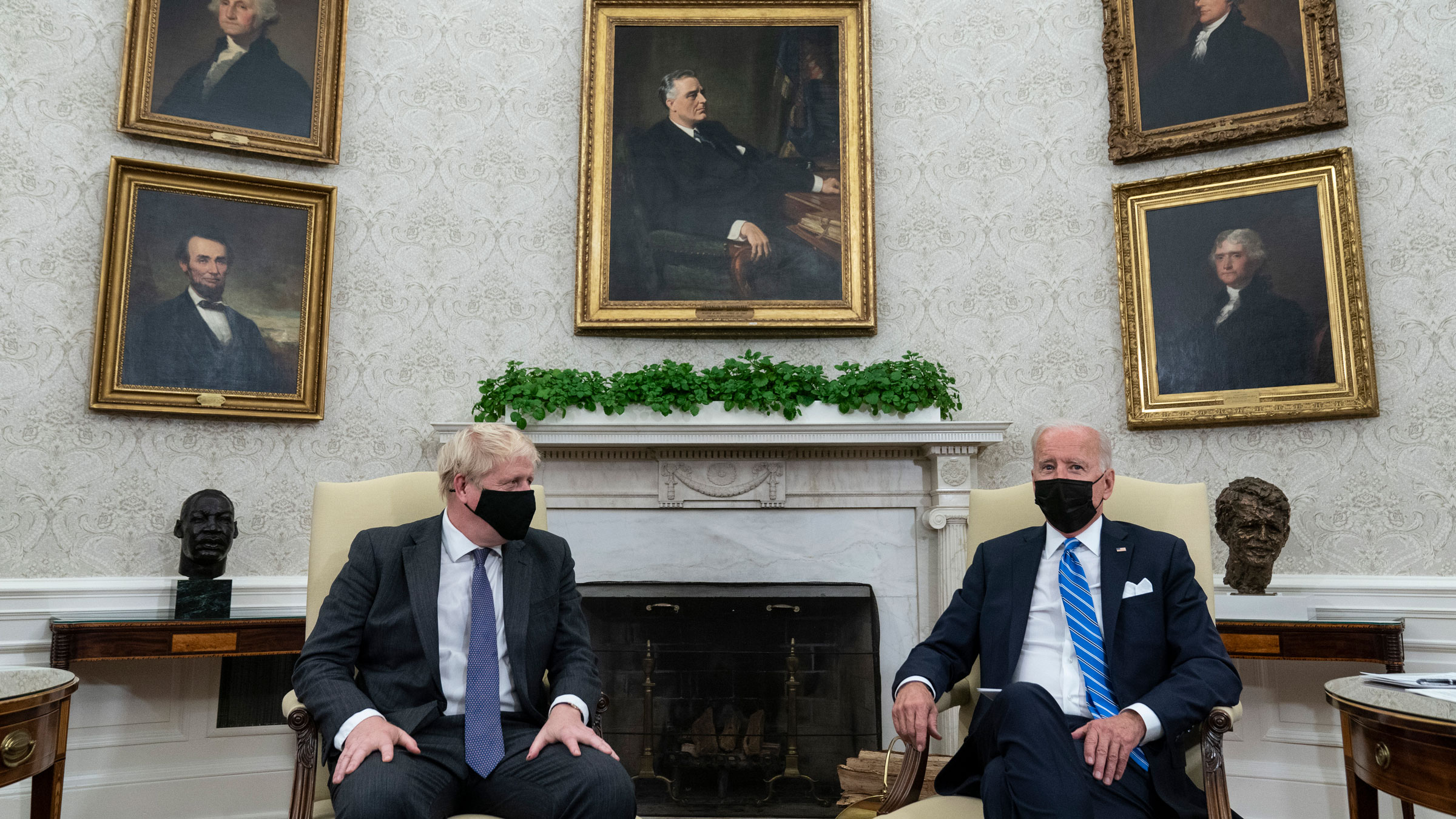 US President Joe Biden, right, speaks during an Oval Office meeting with British Prime Minister Boris Johnson on Tuesday.