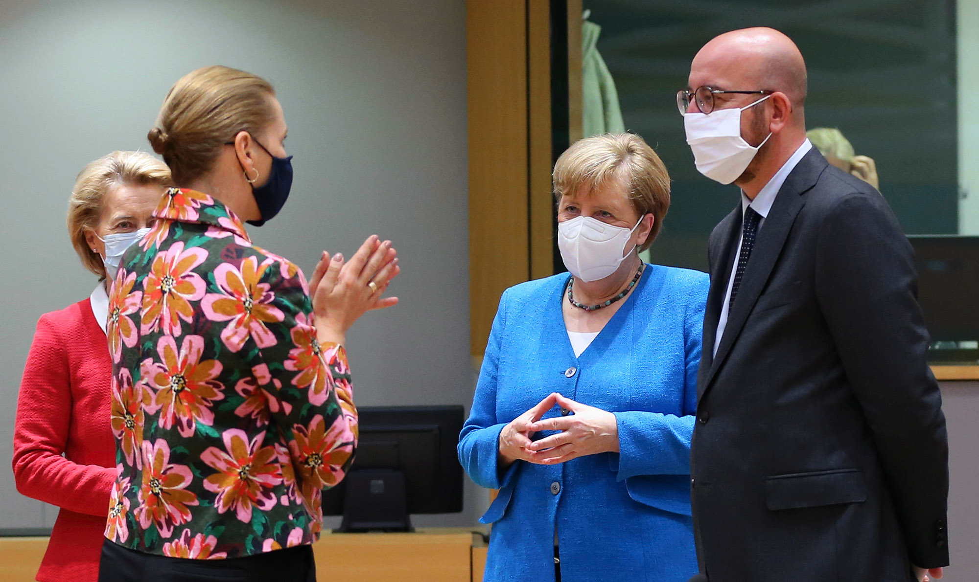 German Chancellor Angela Merkel (2nd R), President of the European Council Charles Michel (R) and Prime Minister of Denmark Mette Frederiksen (L) and Prime Minister of Portugal Antonio Costa (L) attend EU summit to discuss EU's long-term budget and coronavirus recovery plan in Brussels, Belgium on July 18.