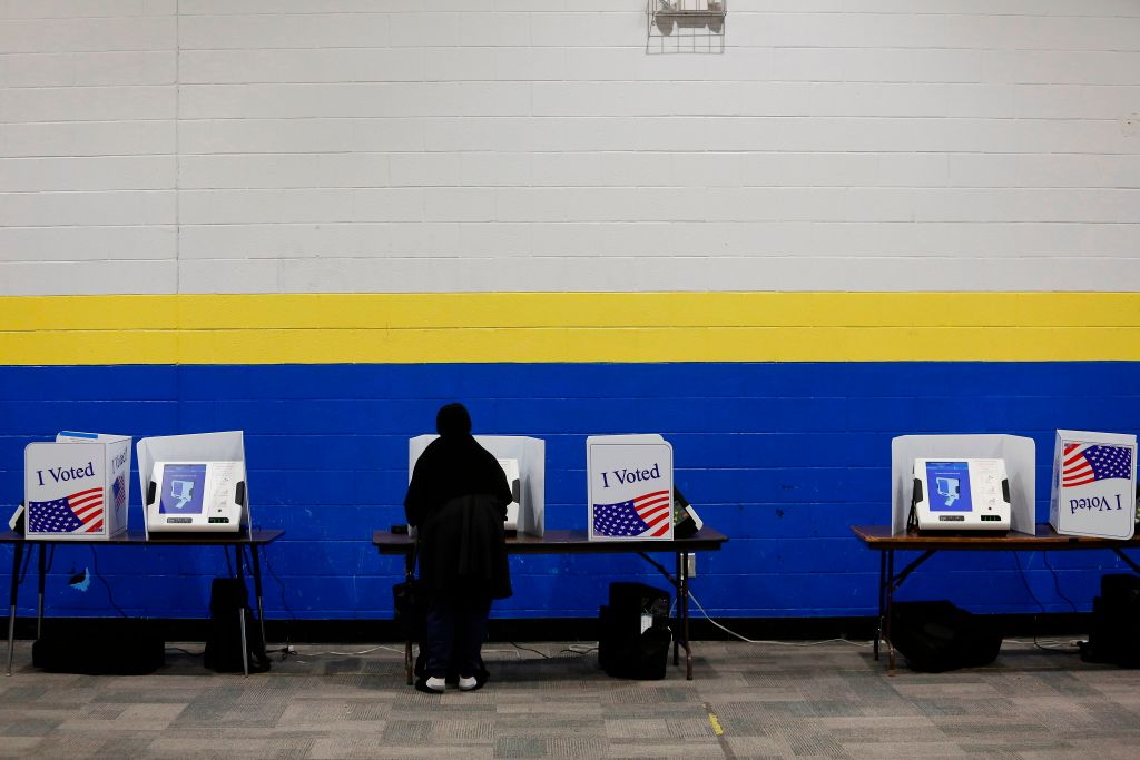 A voter arrives at a polling station located at Mary Ford Elementary School during the primary election in North Charleston, South Carolina, on February 29, 2020.