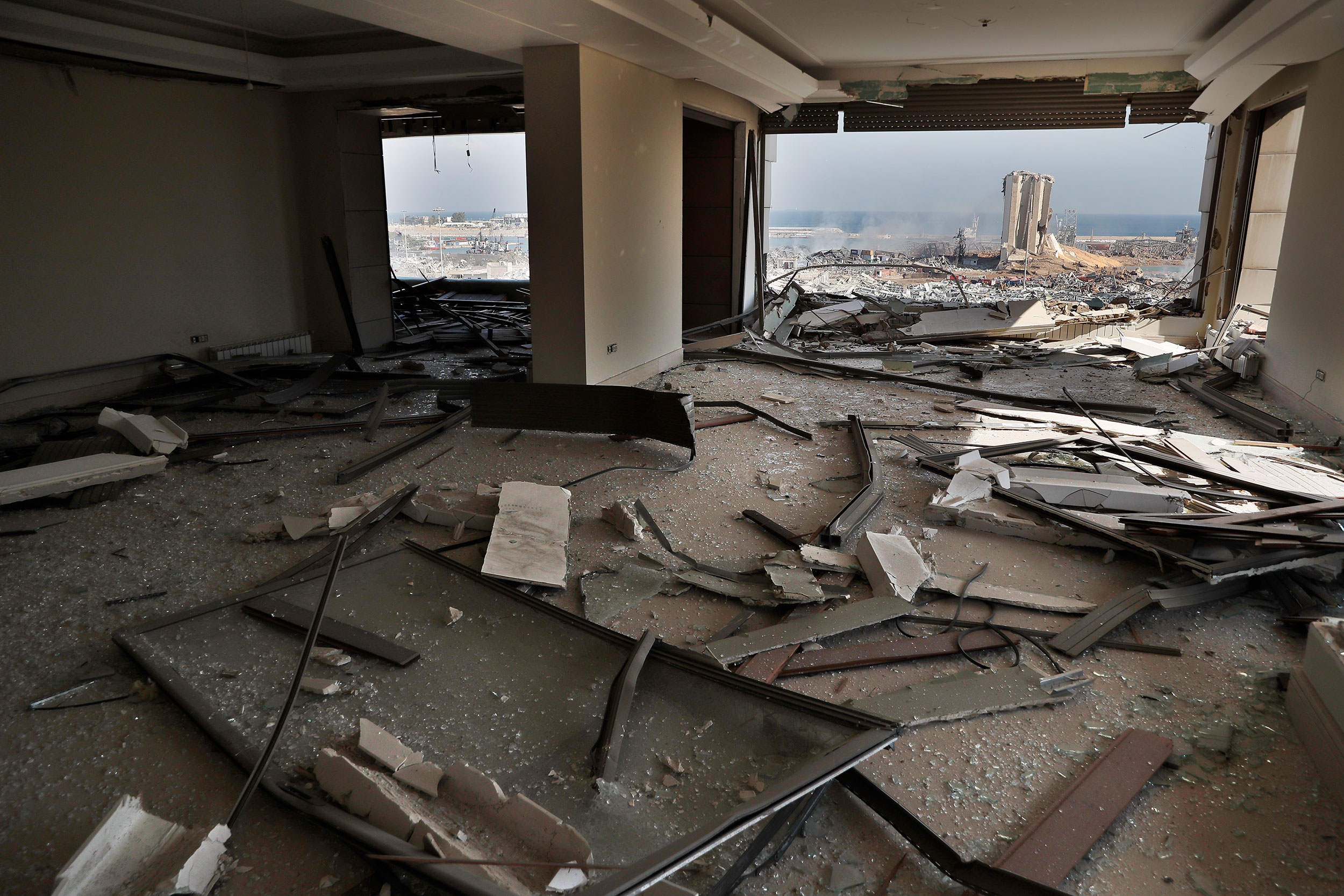 The site of the explosion is seen from a damaged apartment building in Beirut on August 5.