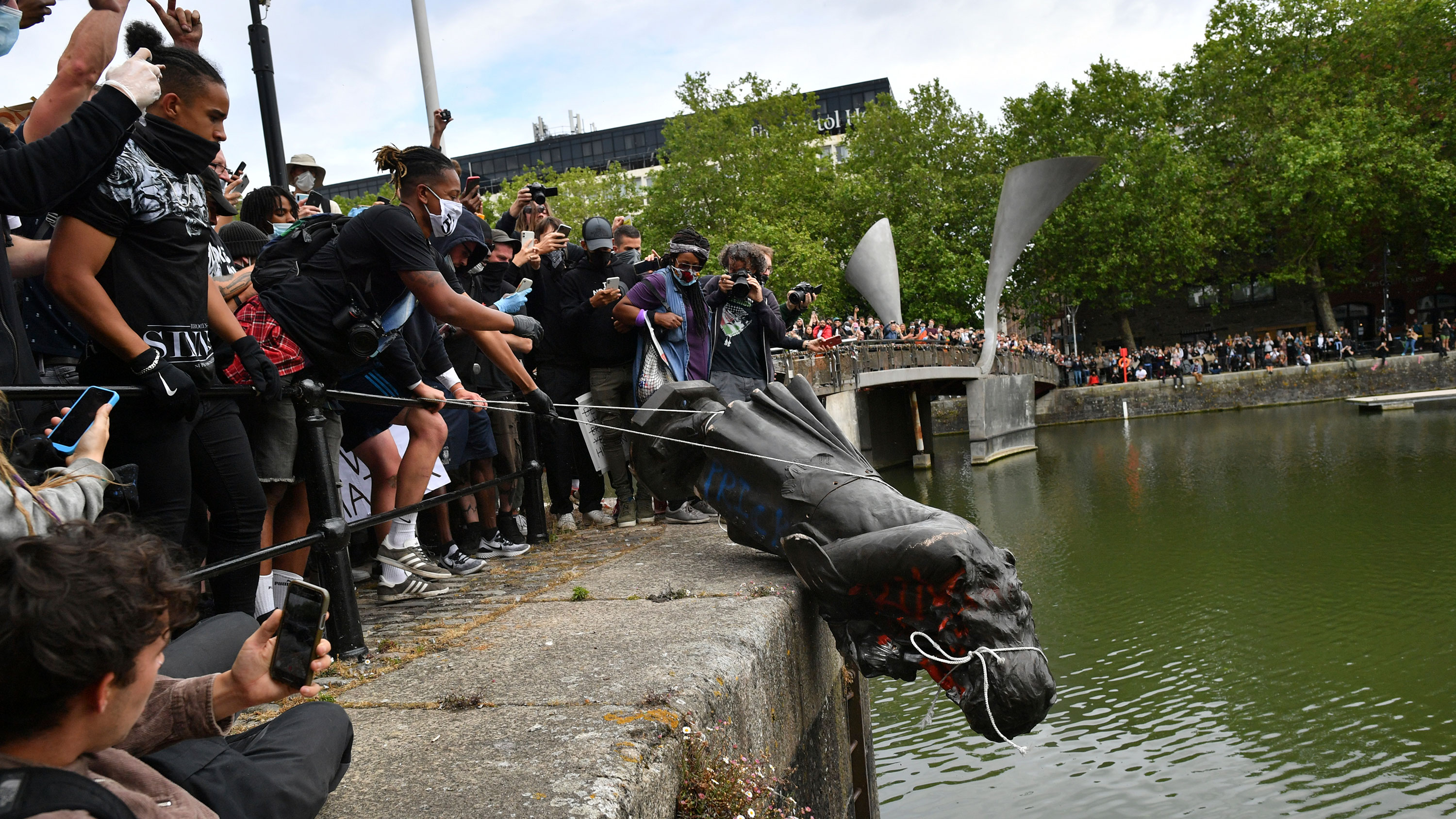 Protesters throw a statue of Edward Colston into Bristol Harbour in Bristol, England, on June 7.