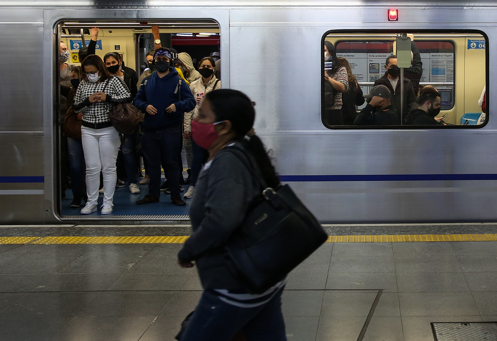 Passengers wearing face masks ride a subway car in downtown Sao Paulo on June 29, in Sao Paulo, Brazil.