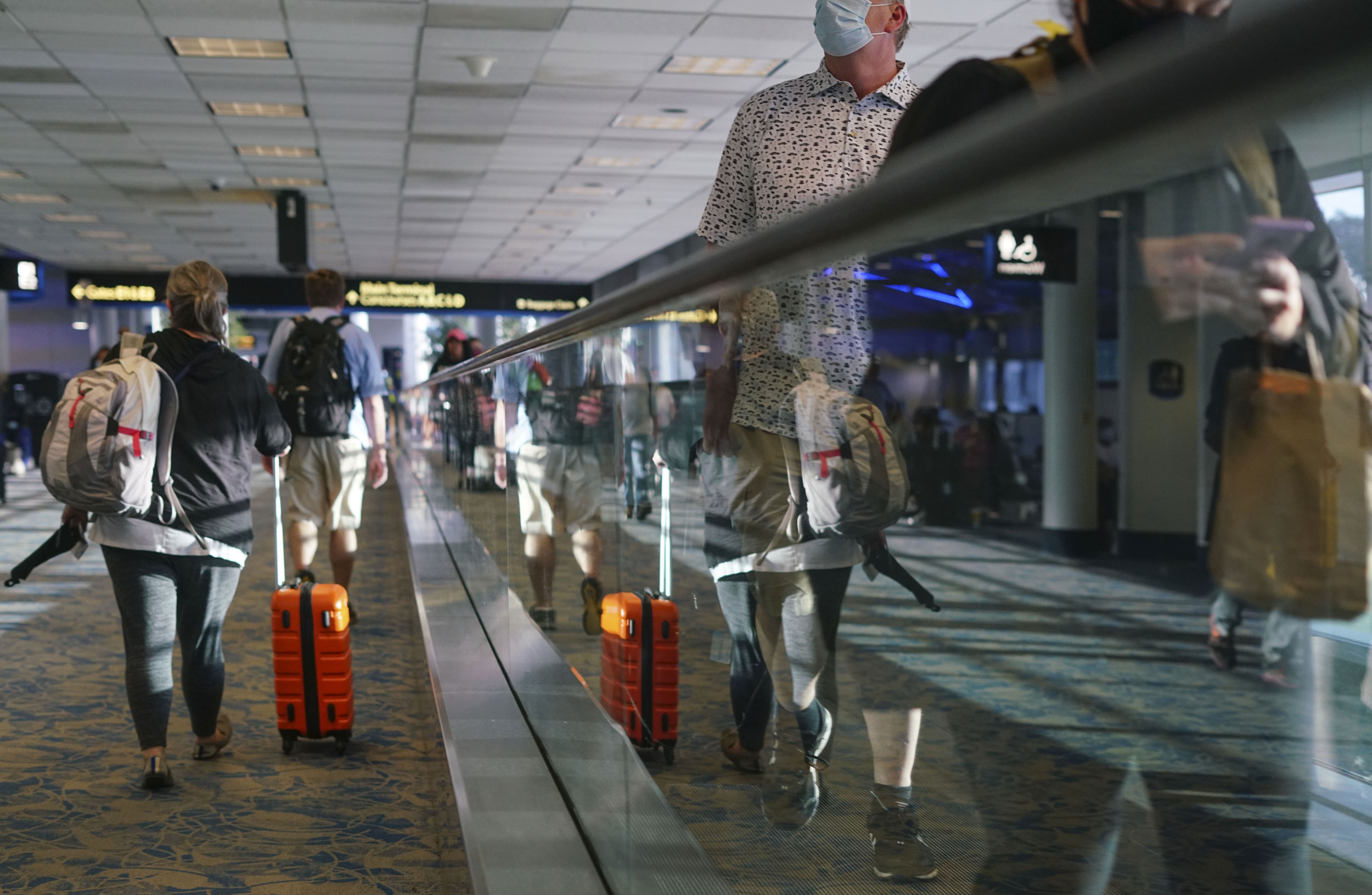 Travelers walk through the Charlotte Douglas International Airport in Charlotte, North Carolina, on June 4.