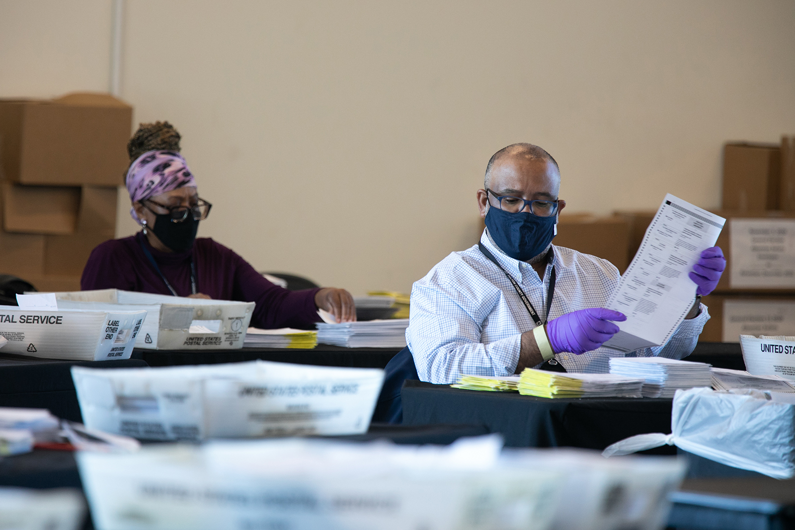 Election workers count Fulton County ballots at State Farm Arena in Atlanta, on November 4.