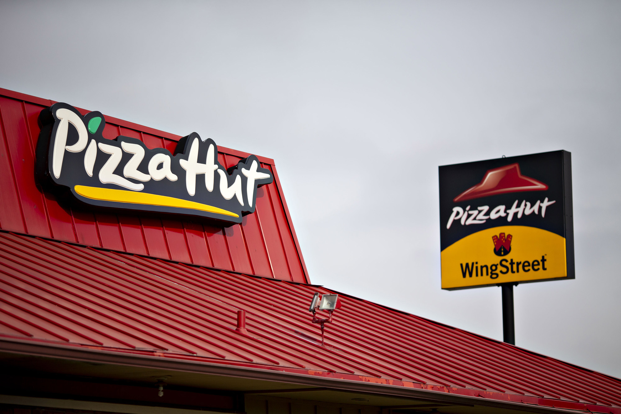 Signage is displayed outside a Yum! Brands Inc. Pizza Hut restaurant on February 5, 2019 in Illinois.